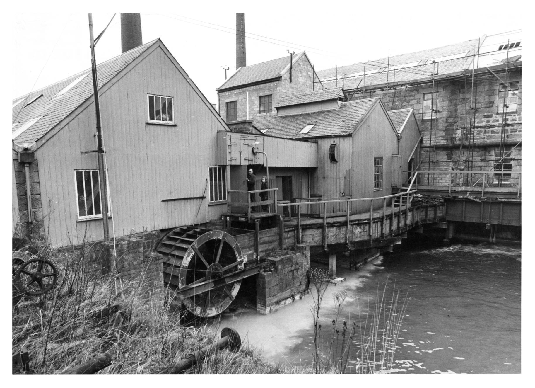 The Thomas Tait mill at Inverurie invested heavily in up-to-date machinery, but still had it's water wheel.
