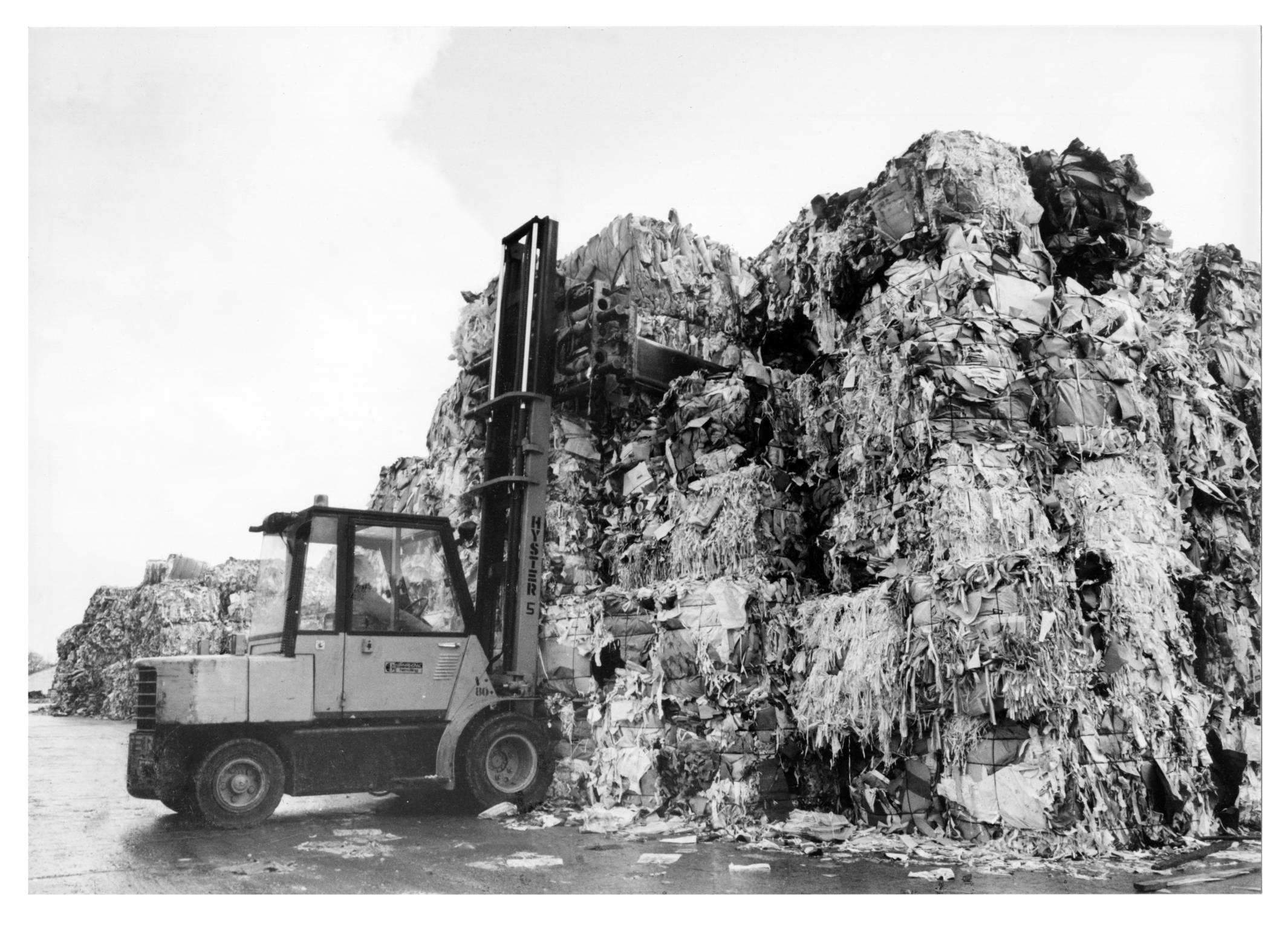 A forklift driver digs into the mound of wasterwater paper at Mugiemoss Mill