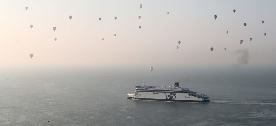 Some of the 100 balloons taking part in a World Record attempt for a mass hot air balloon crossing of the English Channel, fly over a ferry near Dover in Kent. PRESS ASSOCIATION Photo. Picture date: Friday April 7, 2017. See PA story AIR Balloons. Photo credit should read: Gareth Fuller/PA Wire
