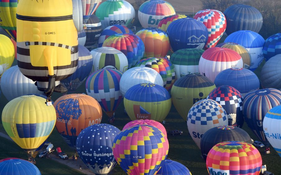 Some of the 100 balloons taking part in a World Record attempt for a mass hot air balloon crossing of the English Channel, set off from Dover in Kent. PRESS ASSOCIATION Photo. Picture date: Friday April 7, 2017. See PA story AIR Balloons. Photo credit should read: Victoria Jones/PA Wire