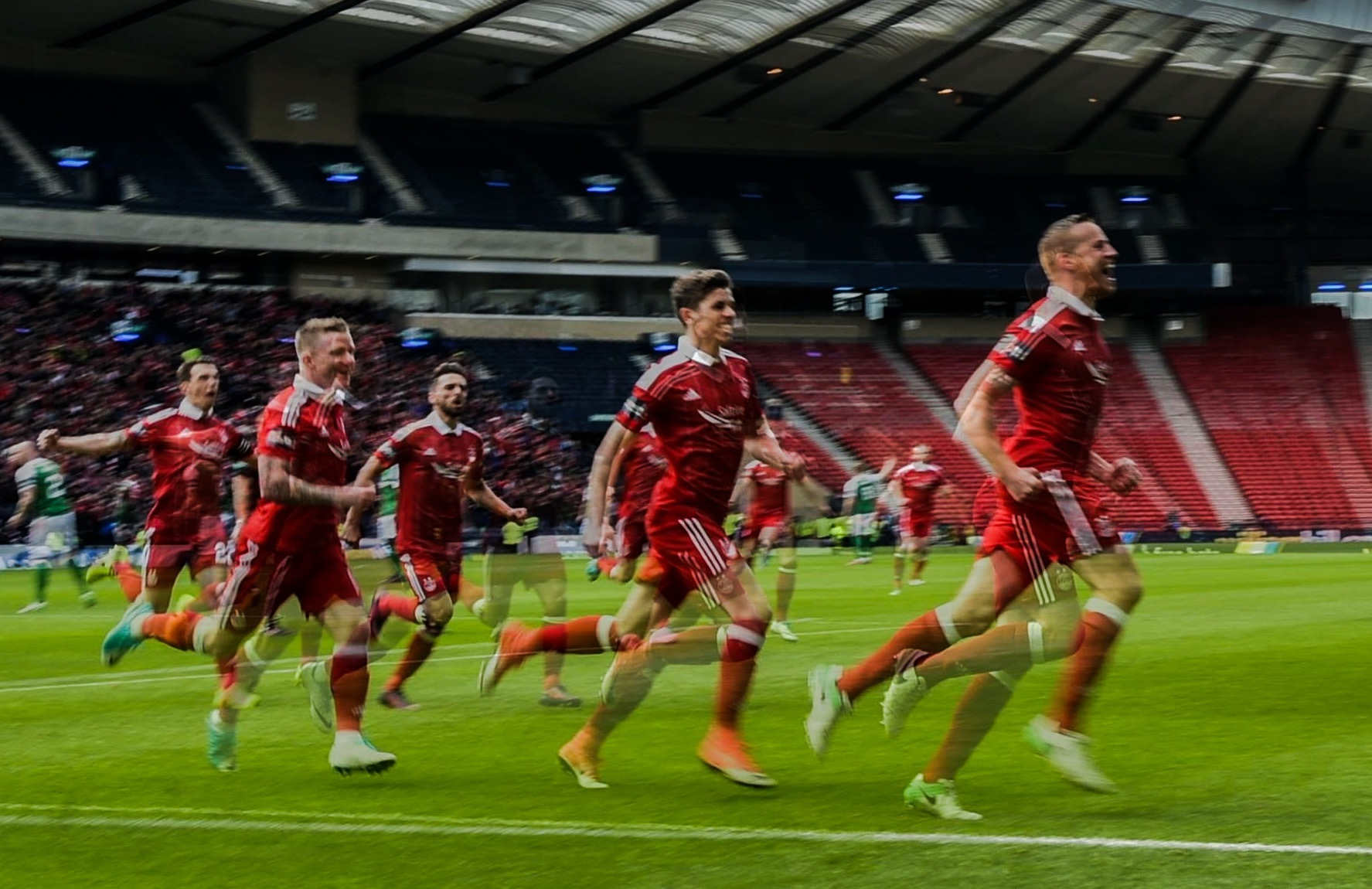 It's all a blur as Aberdeen celebrate their Scottish Cup semi-final success.  (Picture by Darrell Benns)