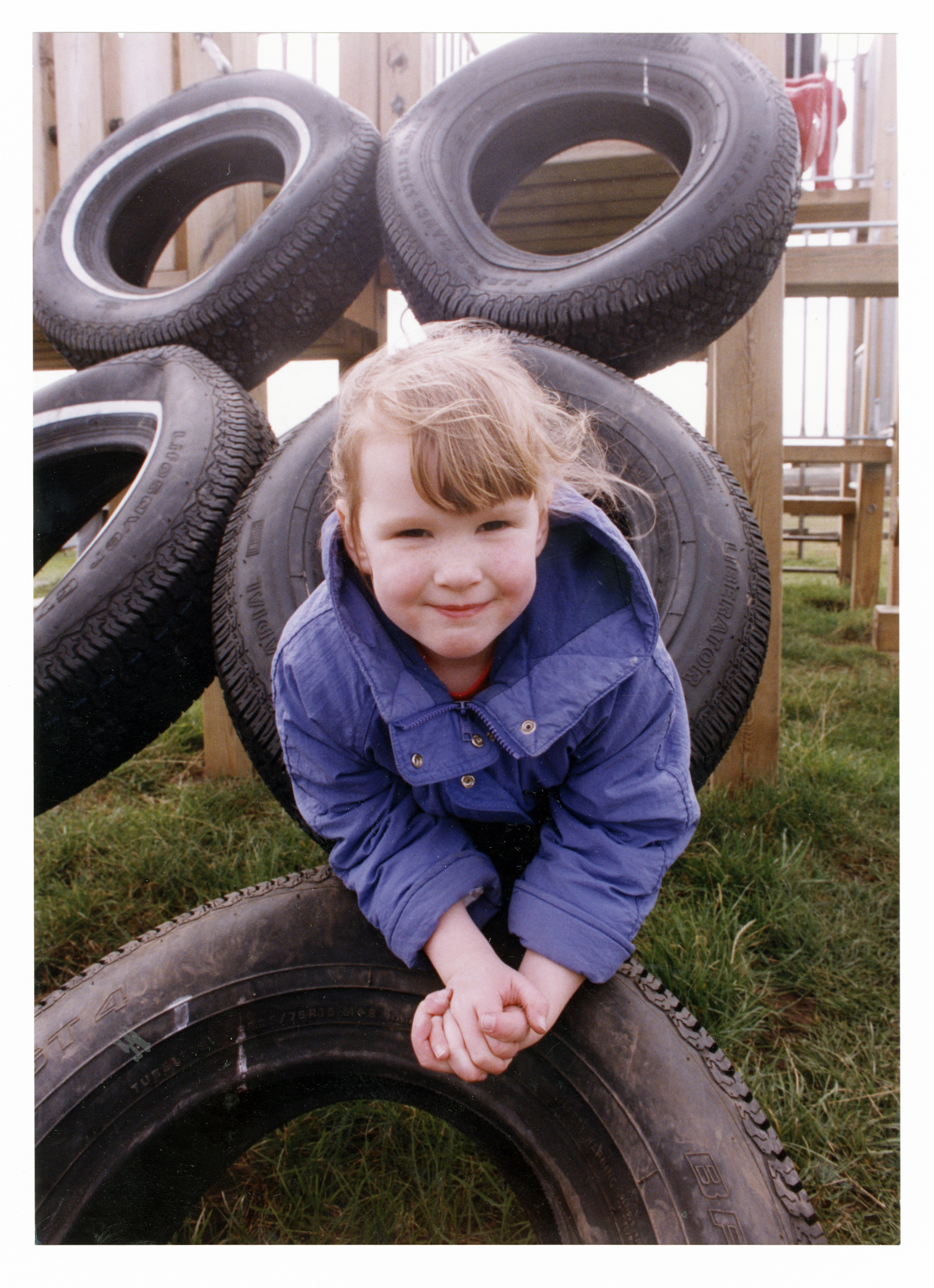 Stephanie Christie clambering into the tyres in the farm's adventure playground.