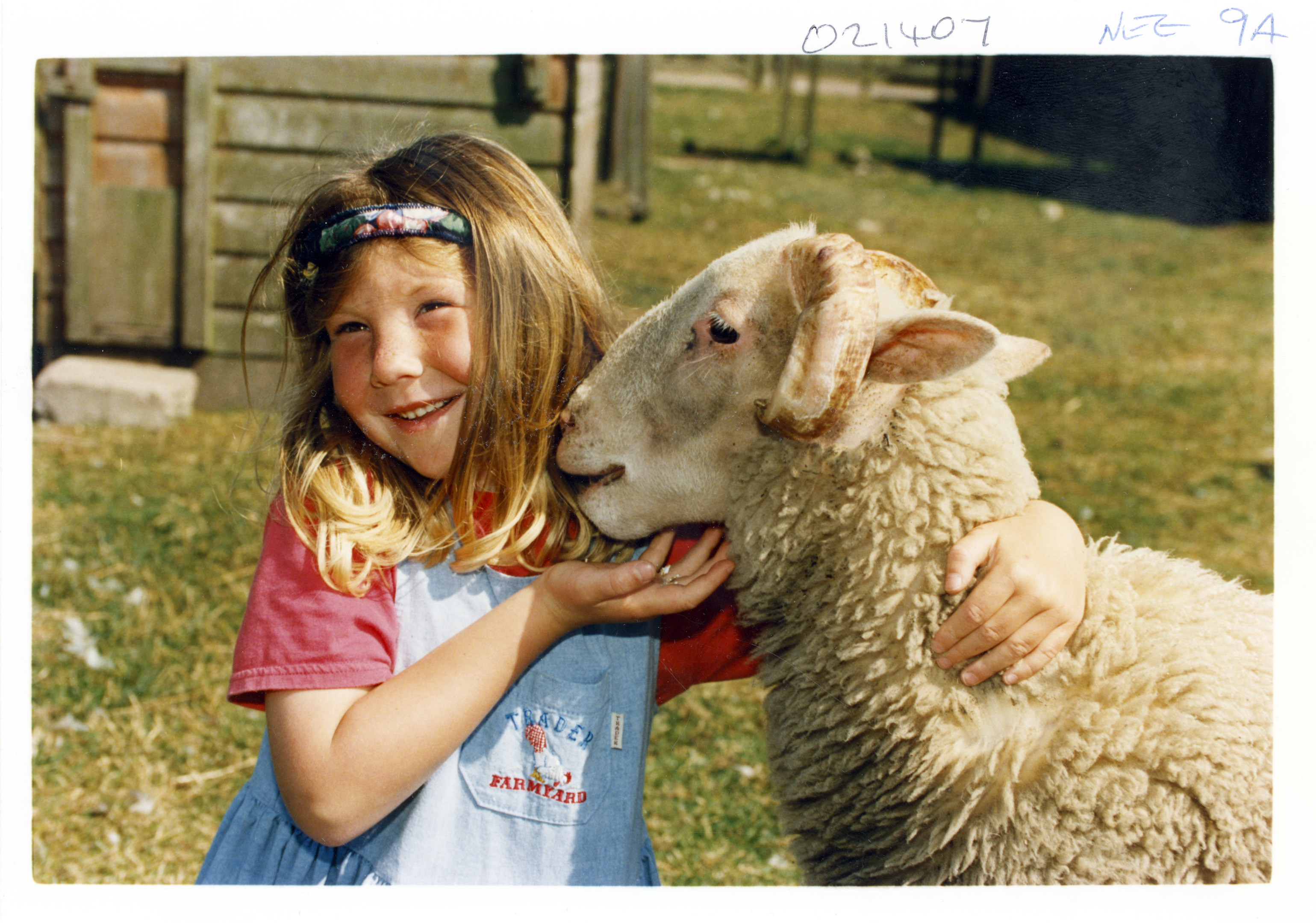 Emma Lennox is taken with her new pal, Snowy the lamb.