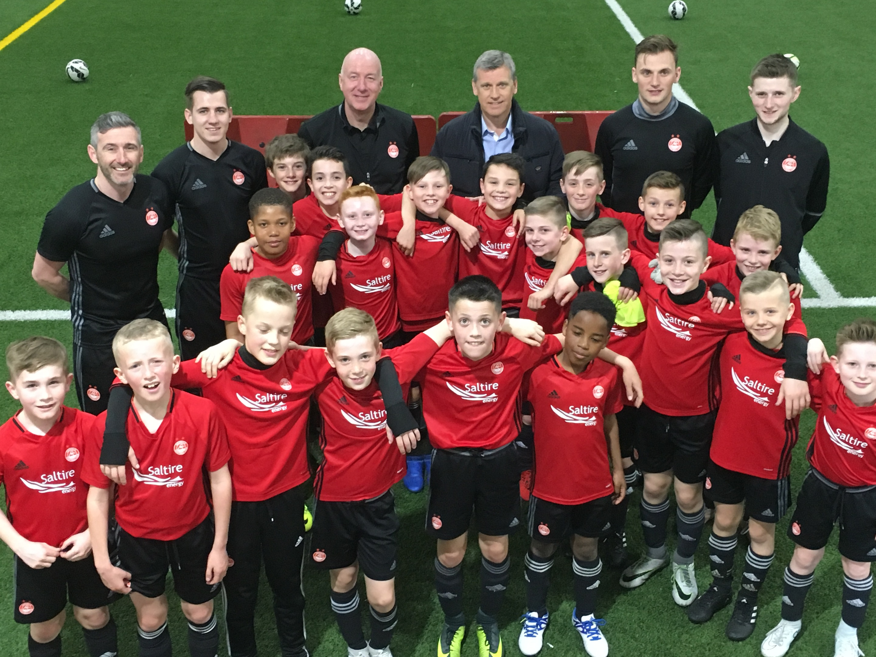 Aberdeen Under-10 and U11 sides with Dons legends Neil Simpson, back row, third from left, and Eric Black, beside him.
