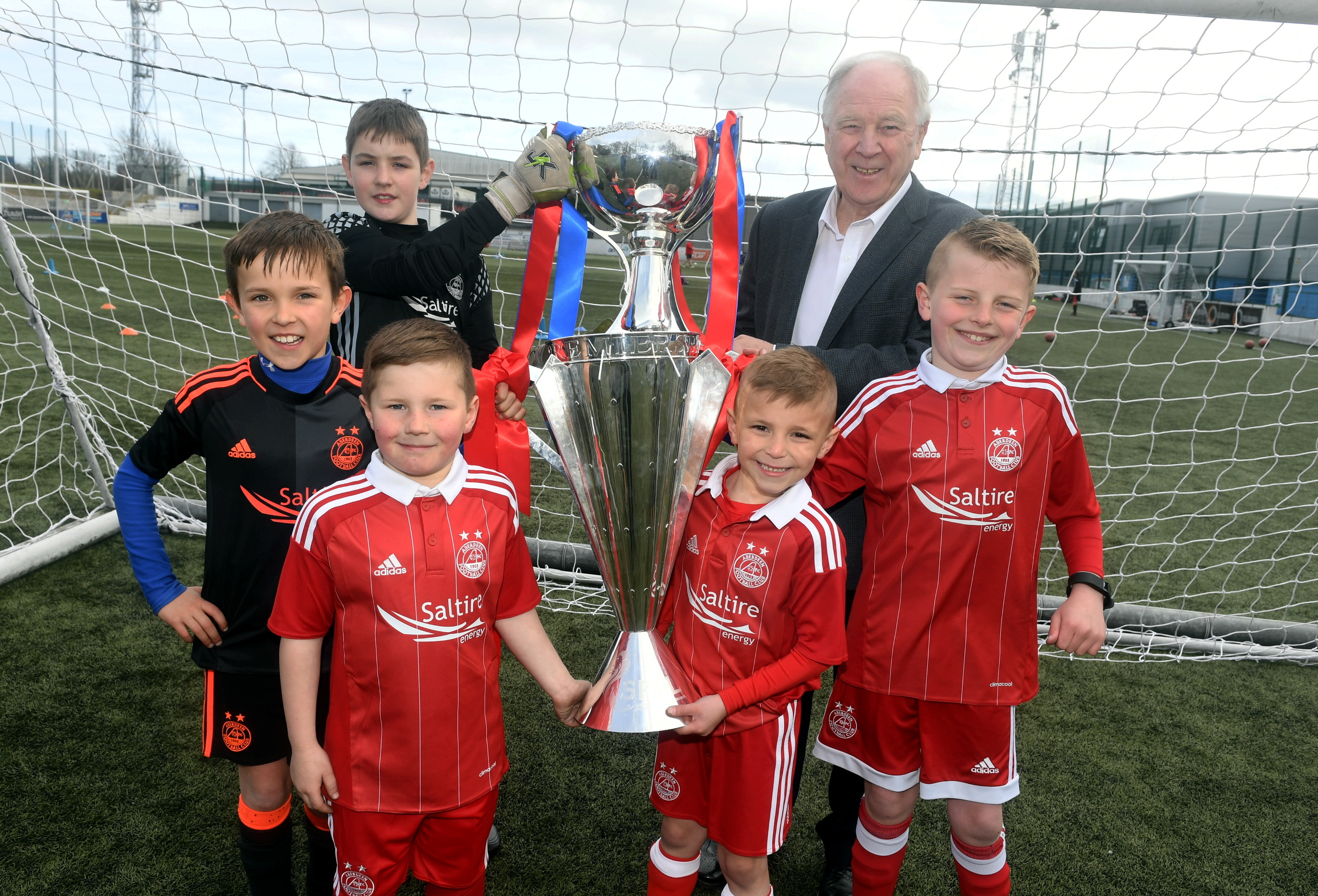 With the Premiership, front,  and League Cup trophies are, back, from left,   Taylor Crombie, 12, Craig Brown. Middle, Calum Strachan, 9, Callum Miller, 8. And, front,  Ryan Nicol, 7, and Alfie Hartley, 8.  picture by chris sumner