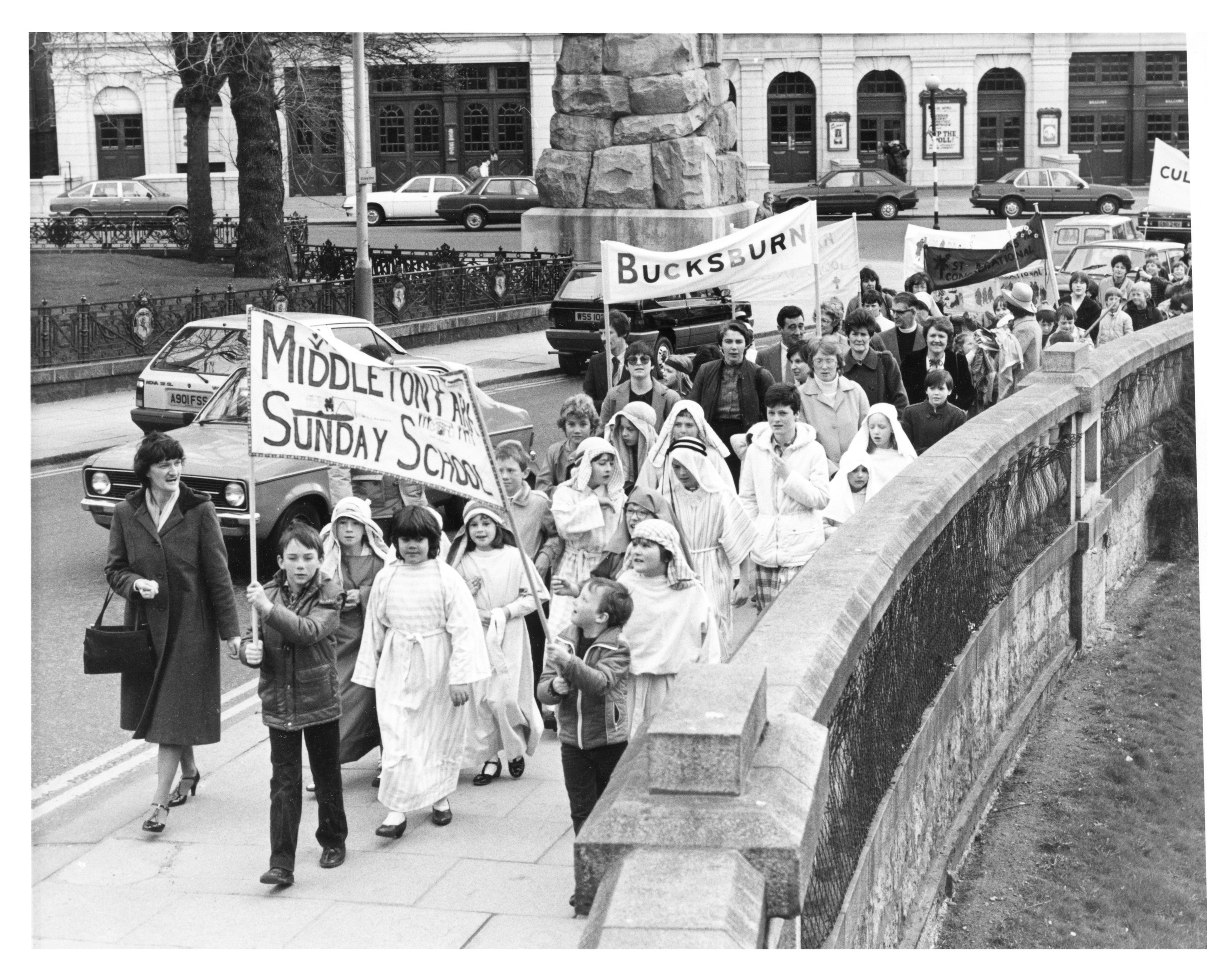sunday schools: Youngsters march from Union Terrace Gardens to the East Church of St Nicholas for a service to mark Palm Sunday.