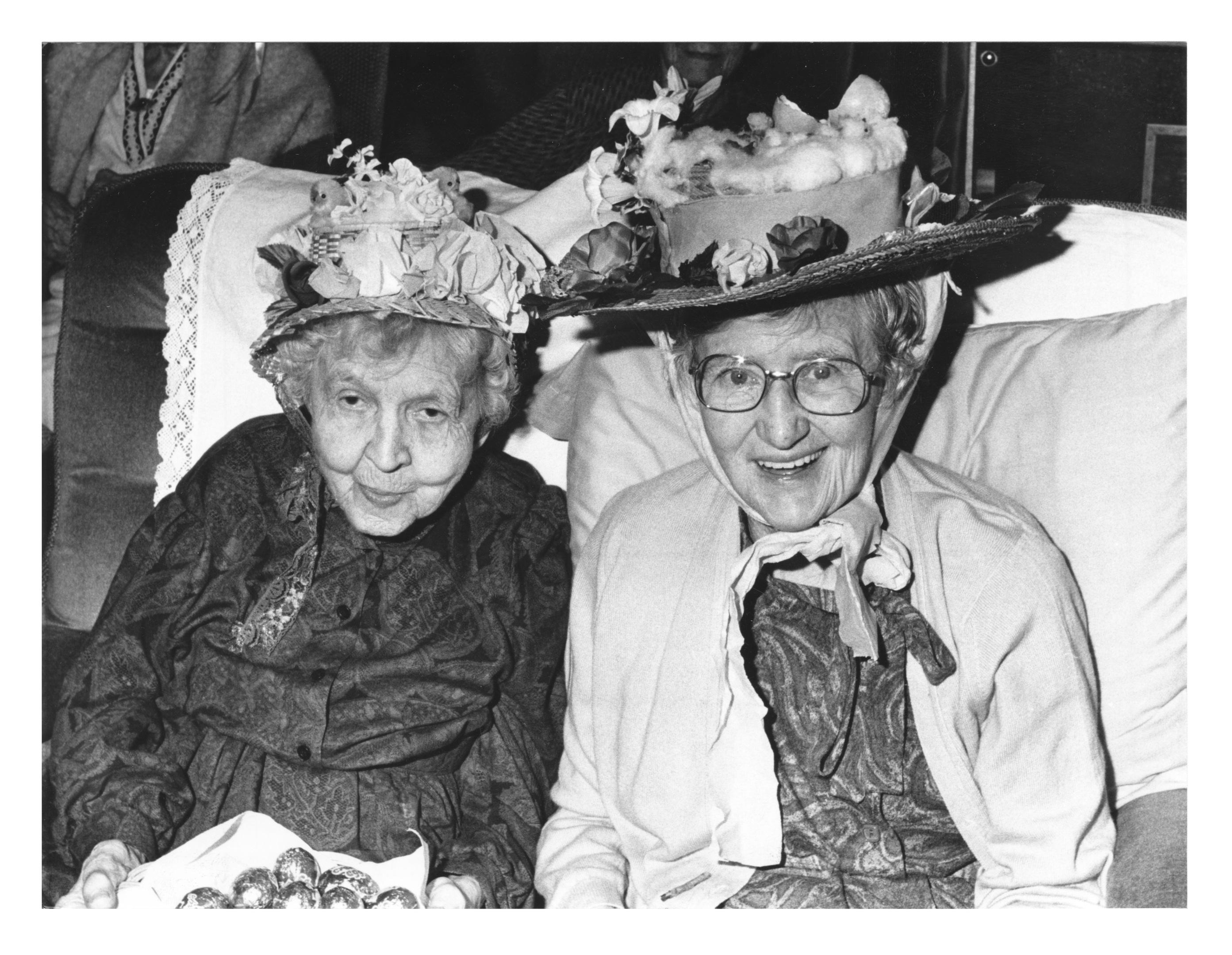 hats off to them: Jenny Sparklaw, left, and Jane Dunn, enjoy Hillside House Nursing Home's Easter bonnet parade.