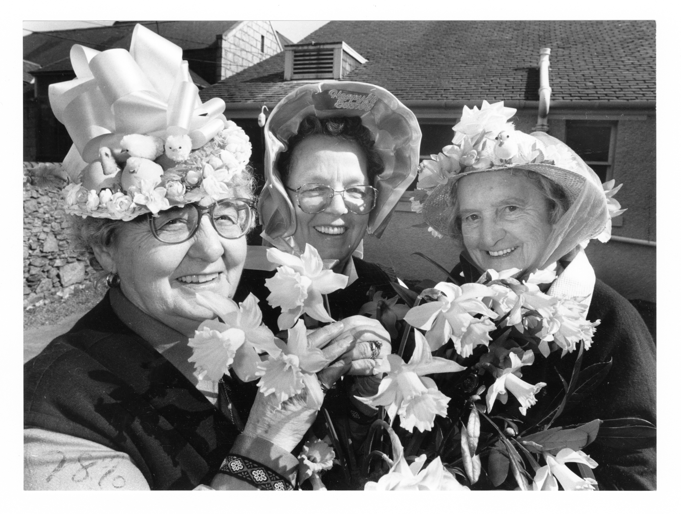smiles: Pensioners, from left, Gertie Pirie, Sarah Murray and Rosie Robertson get in the Easter spirit.