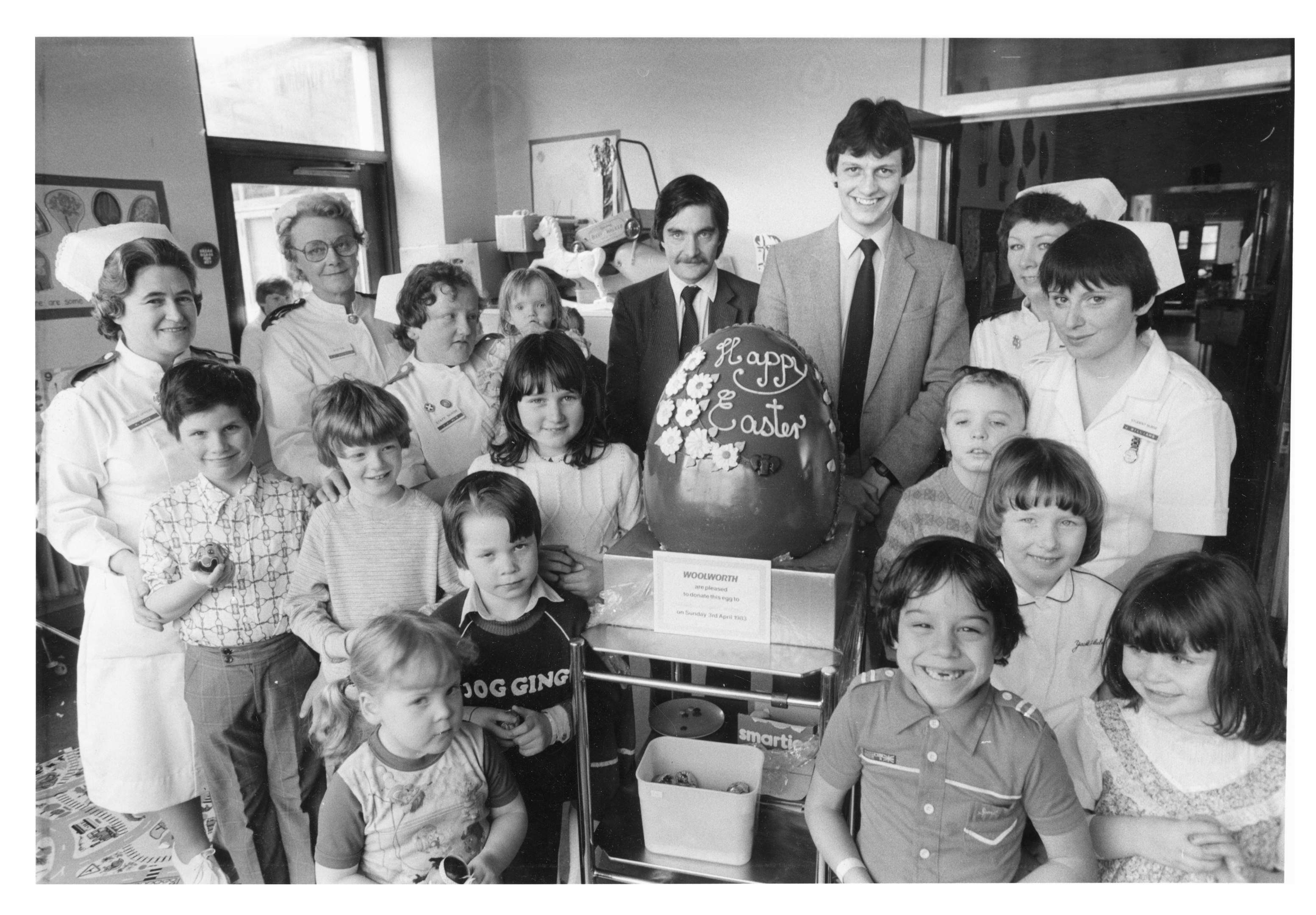 egg-cellent: Woolworth's Alan Waugh and Iain McLeish hand over an Easter egg at Royal Aberdeen Children's Hospital.