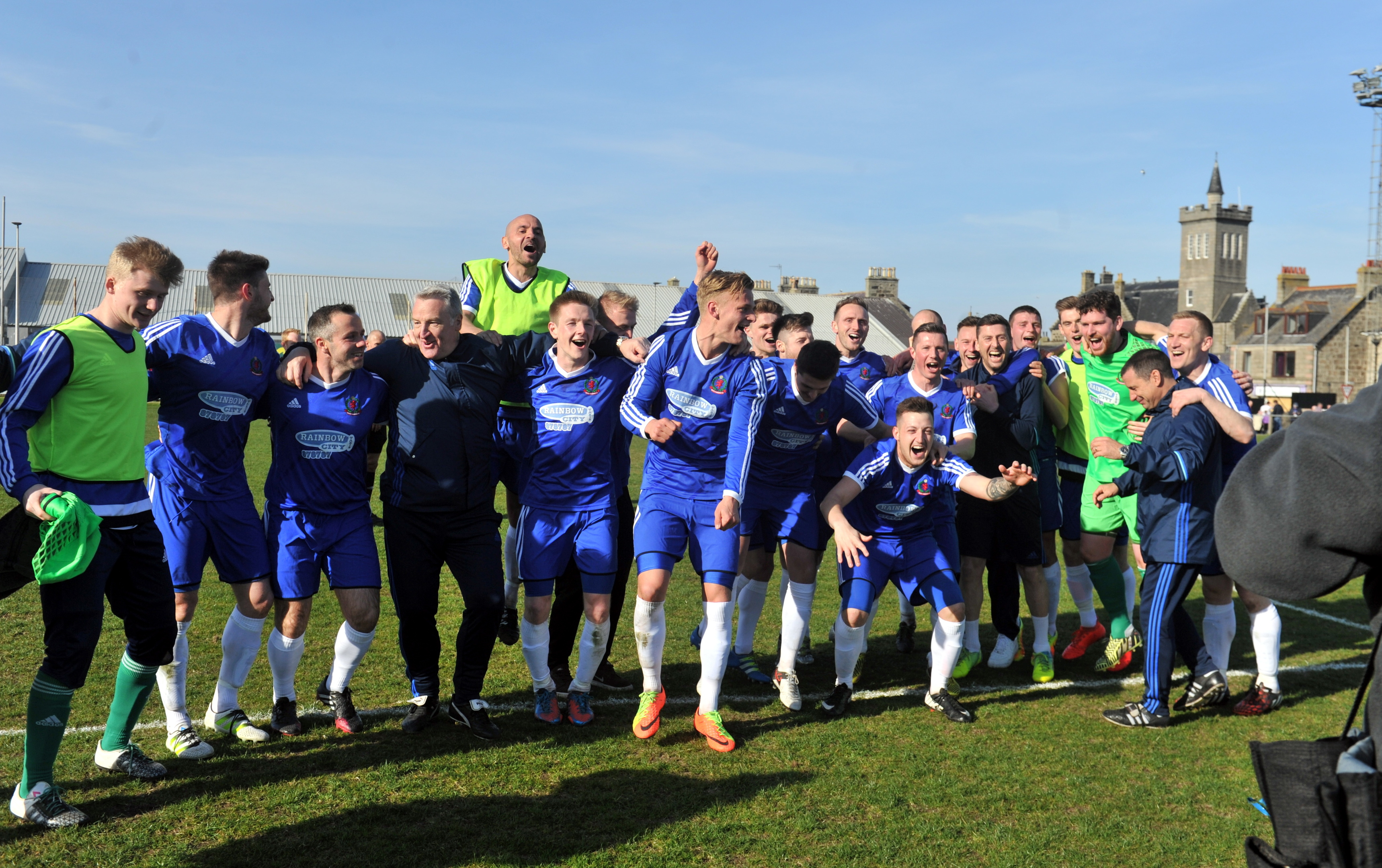 Cove players celebrate their victory over Formartine.