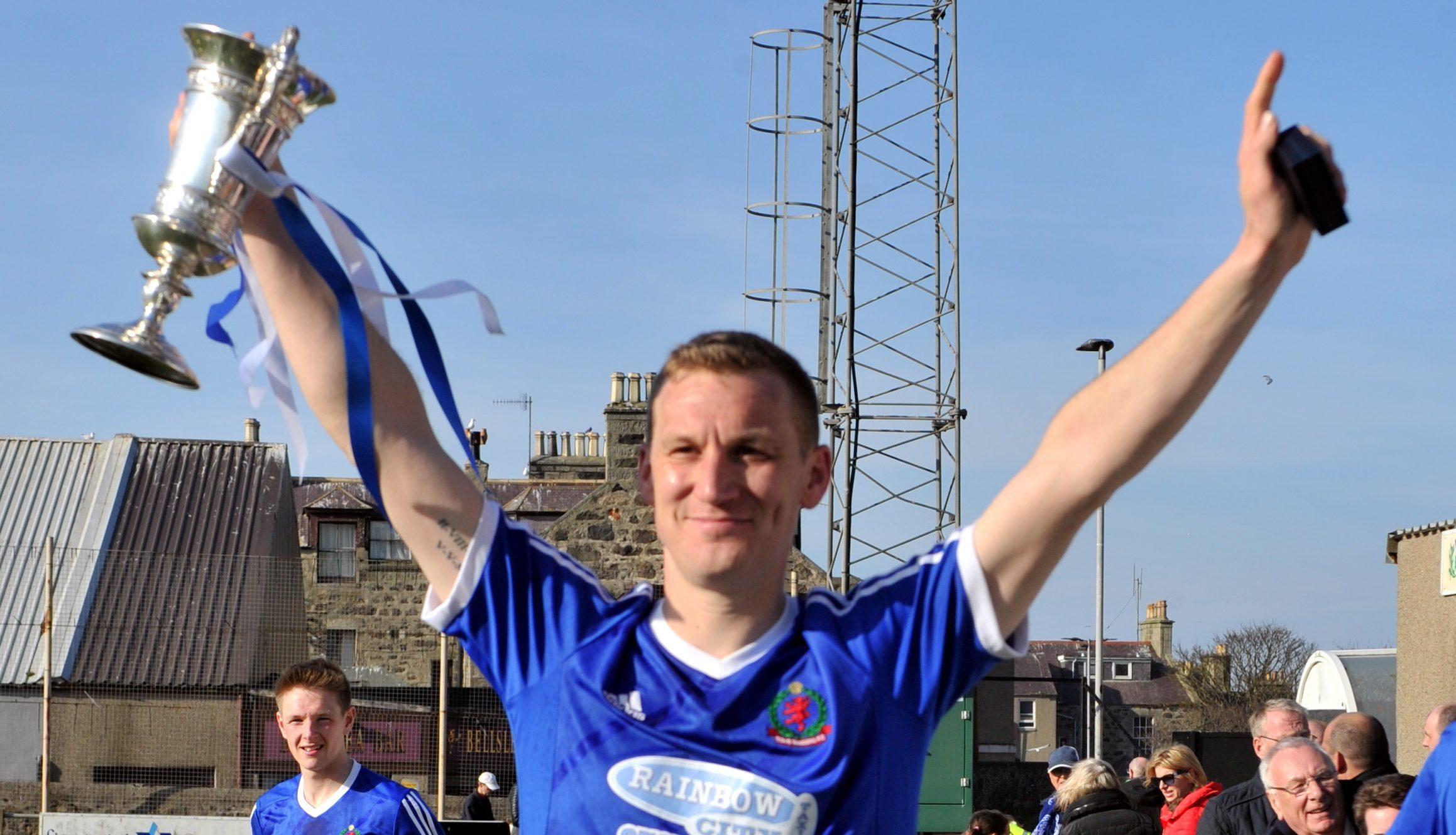 Cove skipper Eric Watson  with the Highland League Cup at Bellslea.