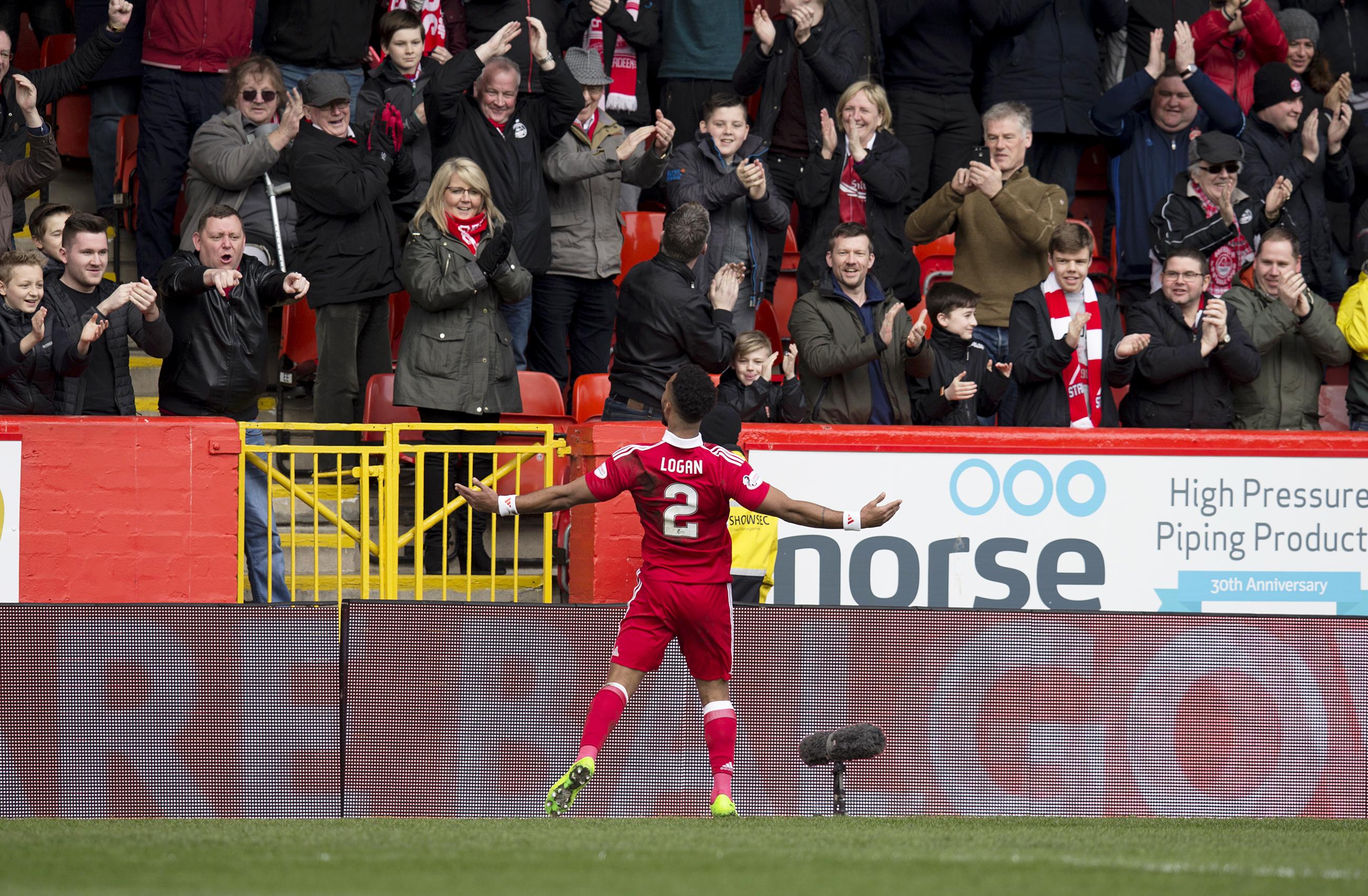 Shay Logan celebrates his goal against Hearts.
