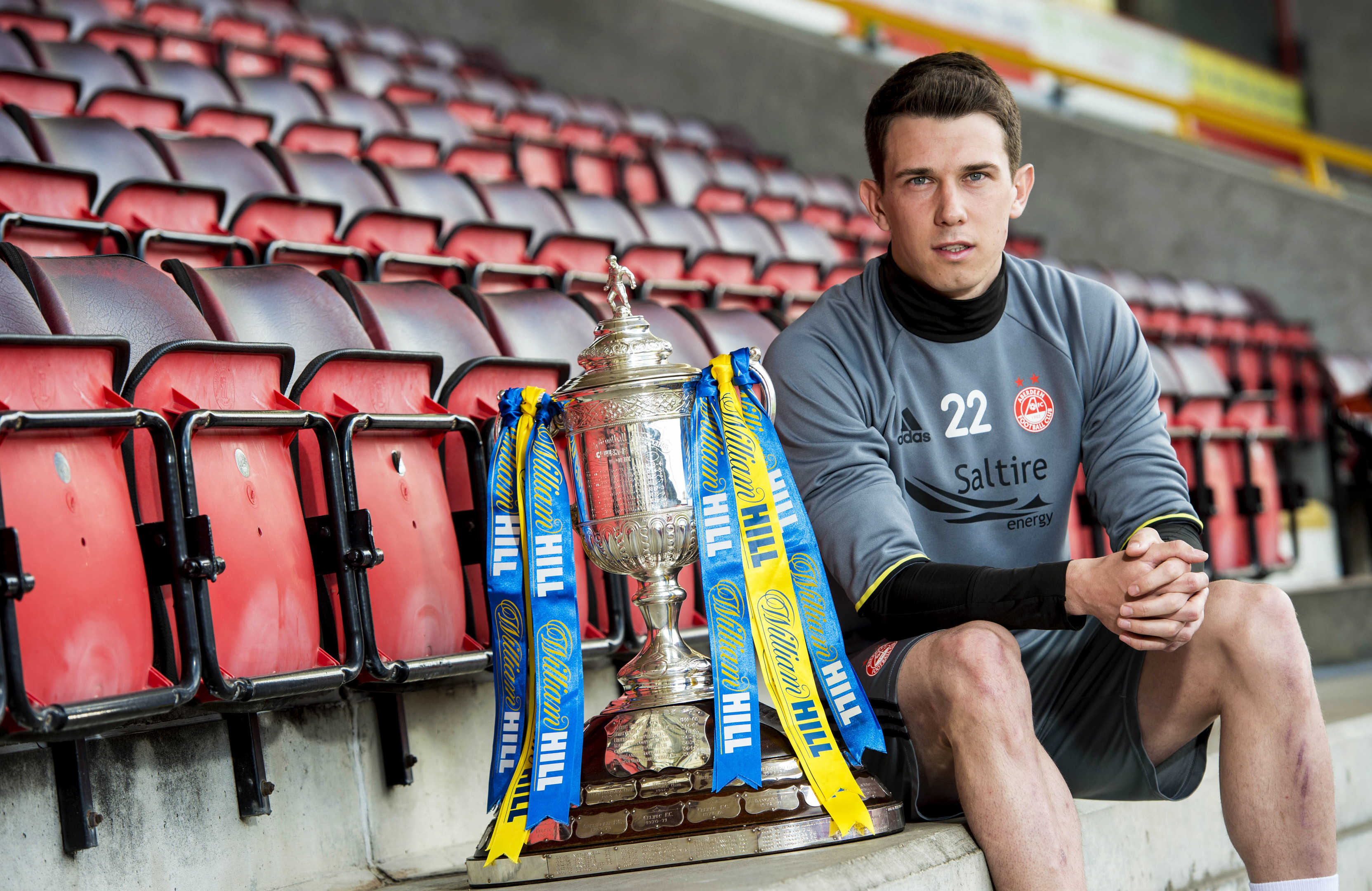 Aberdeen captain Ryan Jack with the Scottish Cup at Pittodrie.