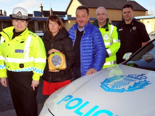 From left, Chief Inspector Louise Blakelock, Sandra and Gordon McKandie, Euan Esslemont of the ambulance service and Gordon Morrison of the Scottish Fire and Rescue Service.