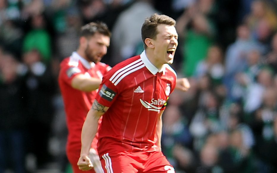 Aberdeen skipper Ryan Jack hails the Reds' victory at full-time.  Pictures by Darrell Benns