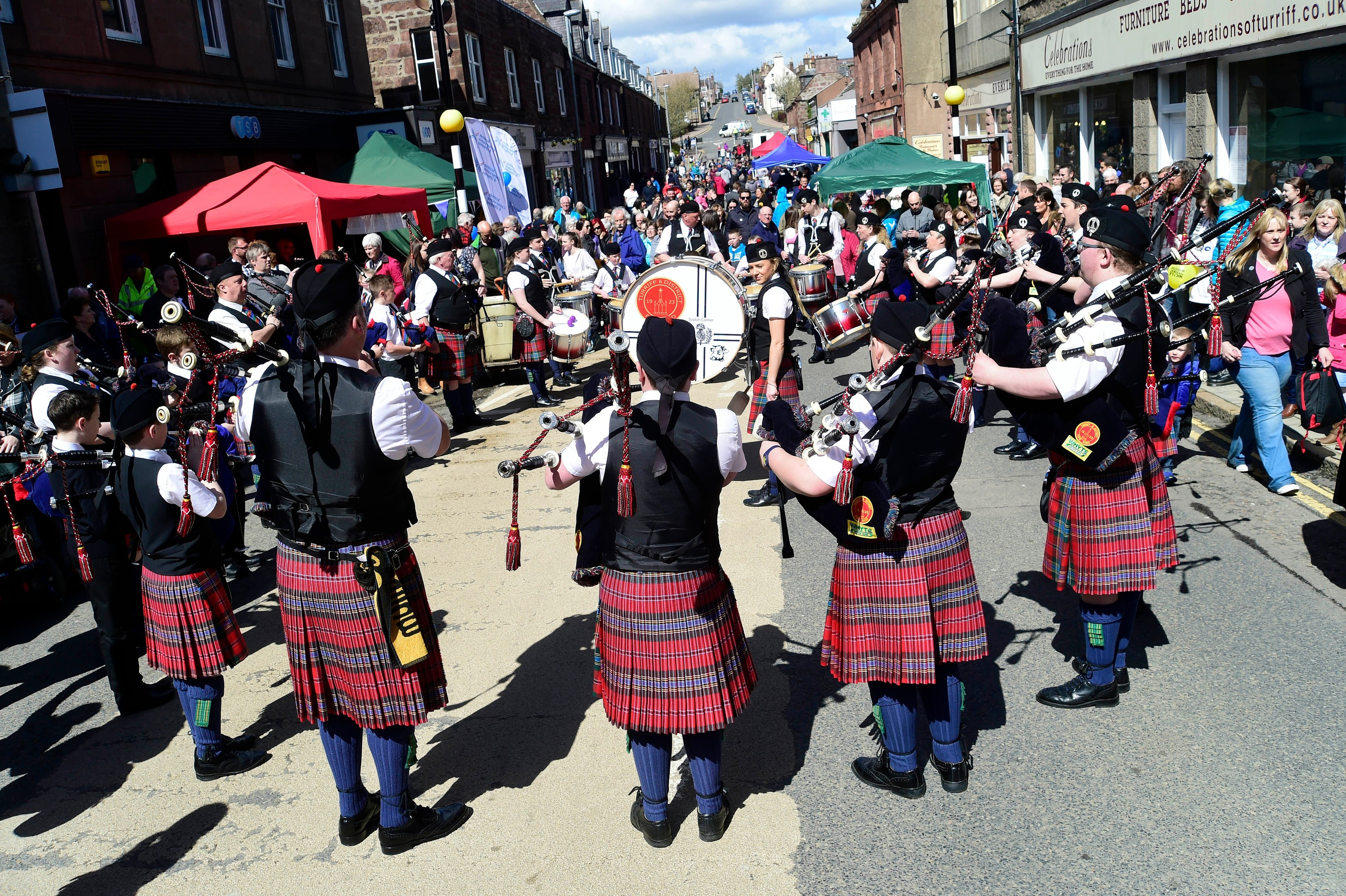 Turriff and District Pipe Band entertain a May Day crowd.