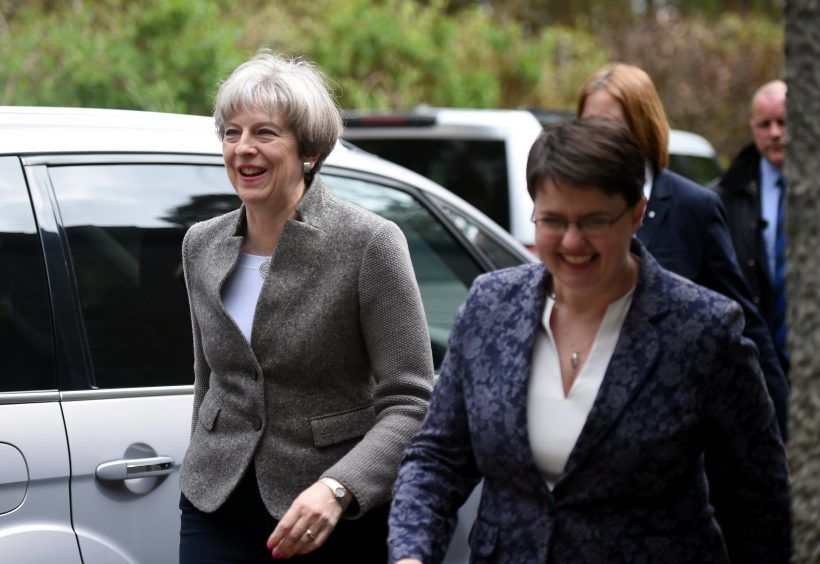 Theresa May giving a speech at Crathes Village Hall, Banchory. Pictured is her arrival- walking with Ruth Davidson. 29/04/17 Picture by HEATHER FOWLIE