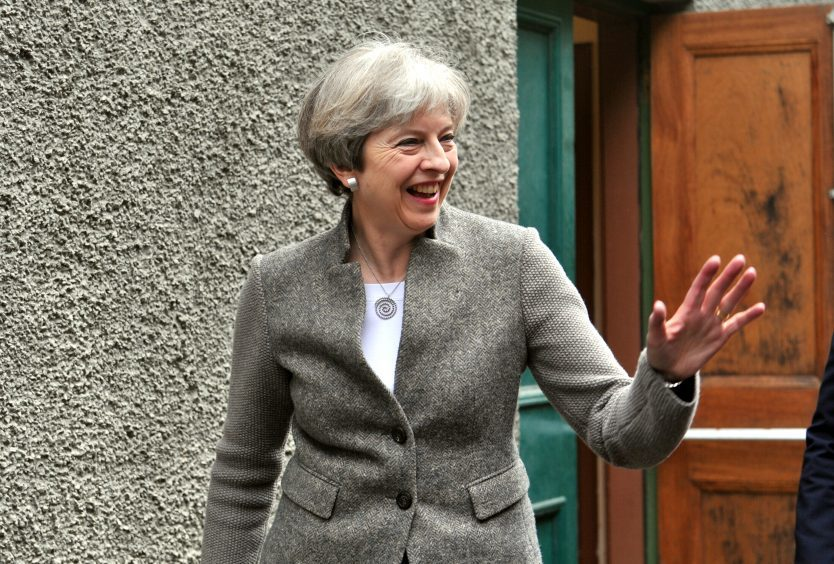 Theresa May giving a speech at Crathes Village Hall, Banchory. Pictured is Theresa May leaving the hall. 29/04/17 Picture by HEATHER FOWLIE