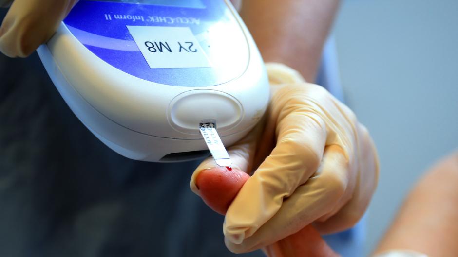 A nurse gives a patient a diabetes test