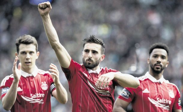 Graeme Shinnie, centre, with Ryan Jack and Shay Logan.
