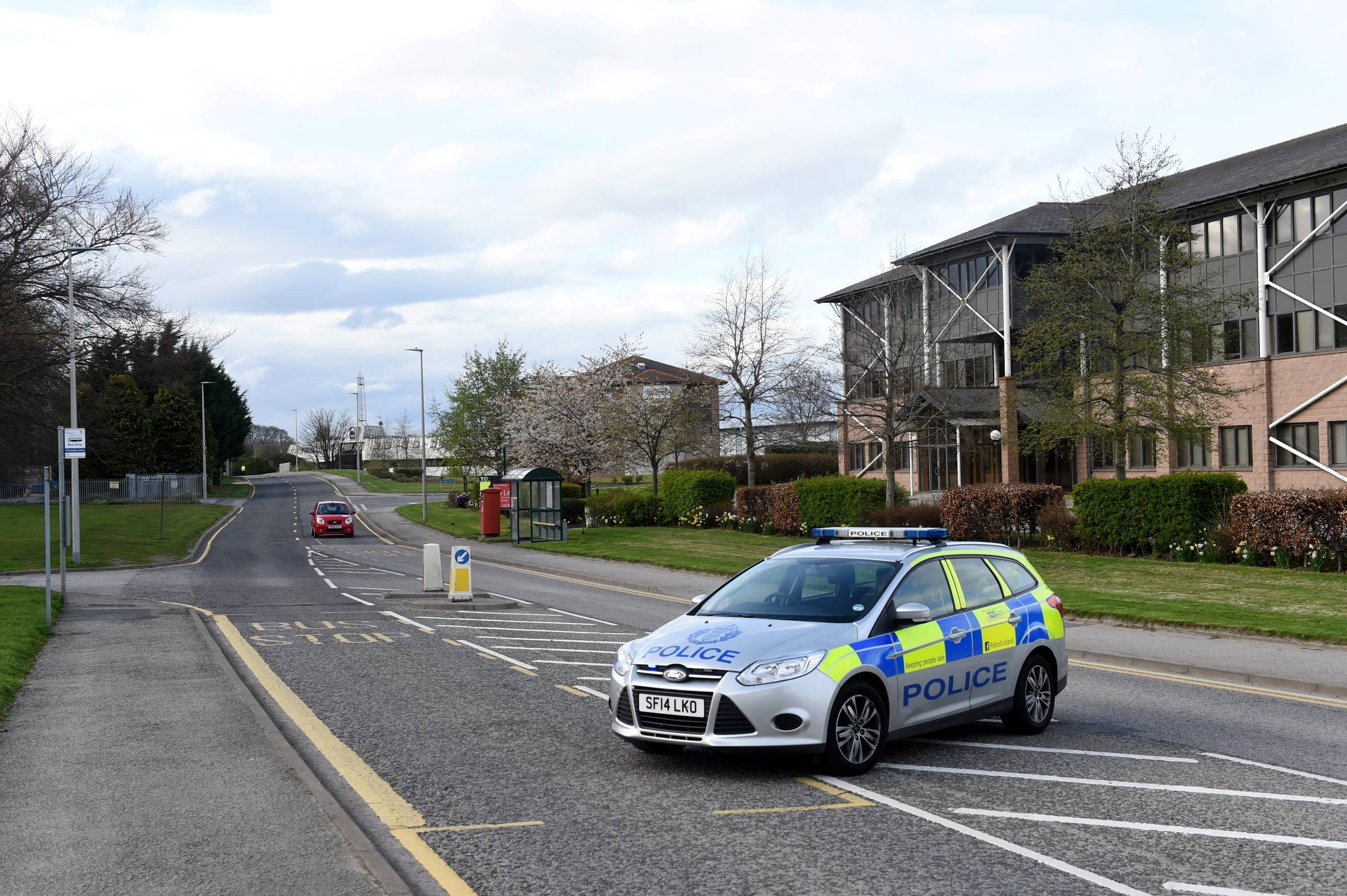 Police on Pitmedden Drive after the recycling centre was sealed off following a bomb scare