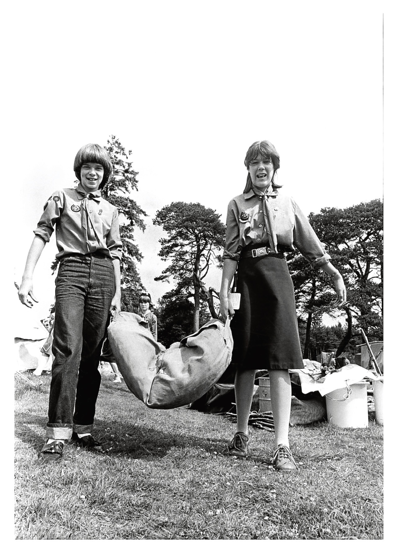 1983: Carrying their home for the week - a heavy tent - are Inverurie Guides Alison Martin, left, and Emily Mason.