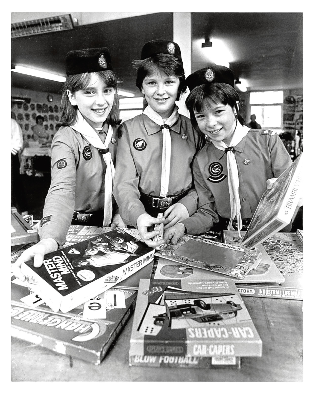 1988: Inverurie Guides Fay Bruce, 11, Edana Lemmon, 10, and Susan Park,11, get the Spring Fair games stall ready.