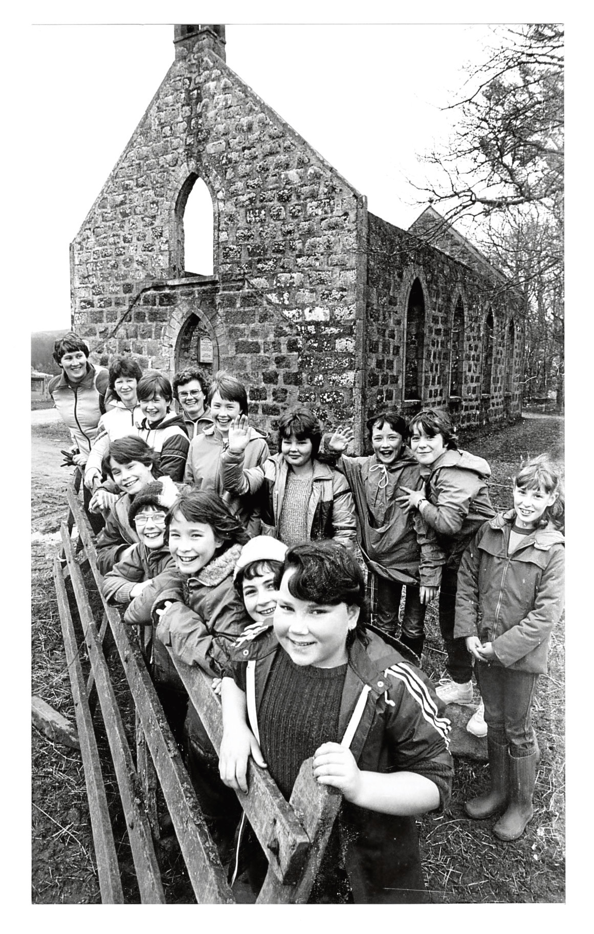 1985: Rhynie Guides enjoying a hike in the country pause outside the ruins of the old Auchindoir Church.