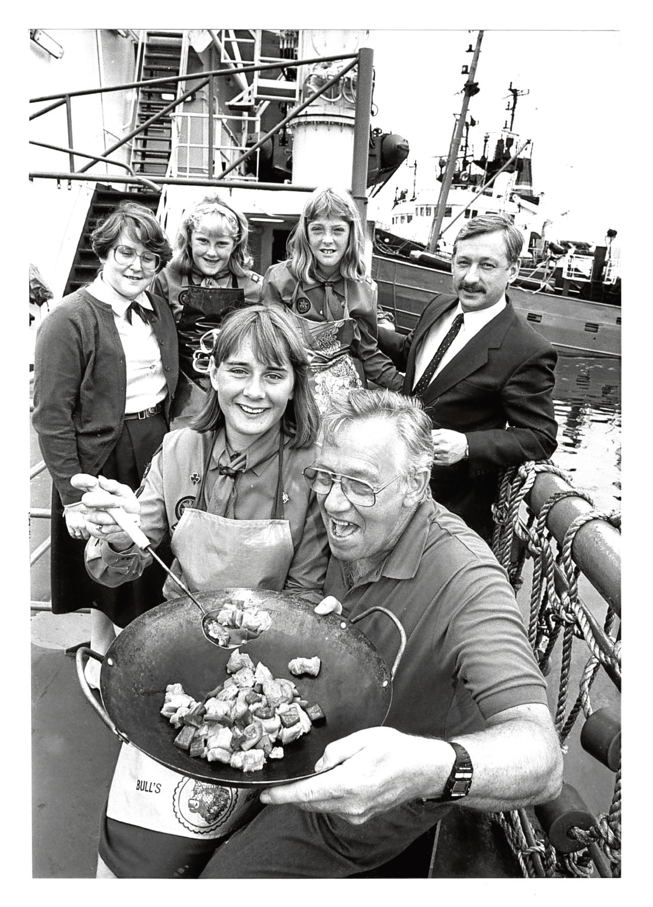 1989: Bridge of Don Guides Alix and Fiona Good and Angela Spence dropped in to cook Frank Quantrill a meal on the standby vessel Grampian Pioneer at Aberdeen.