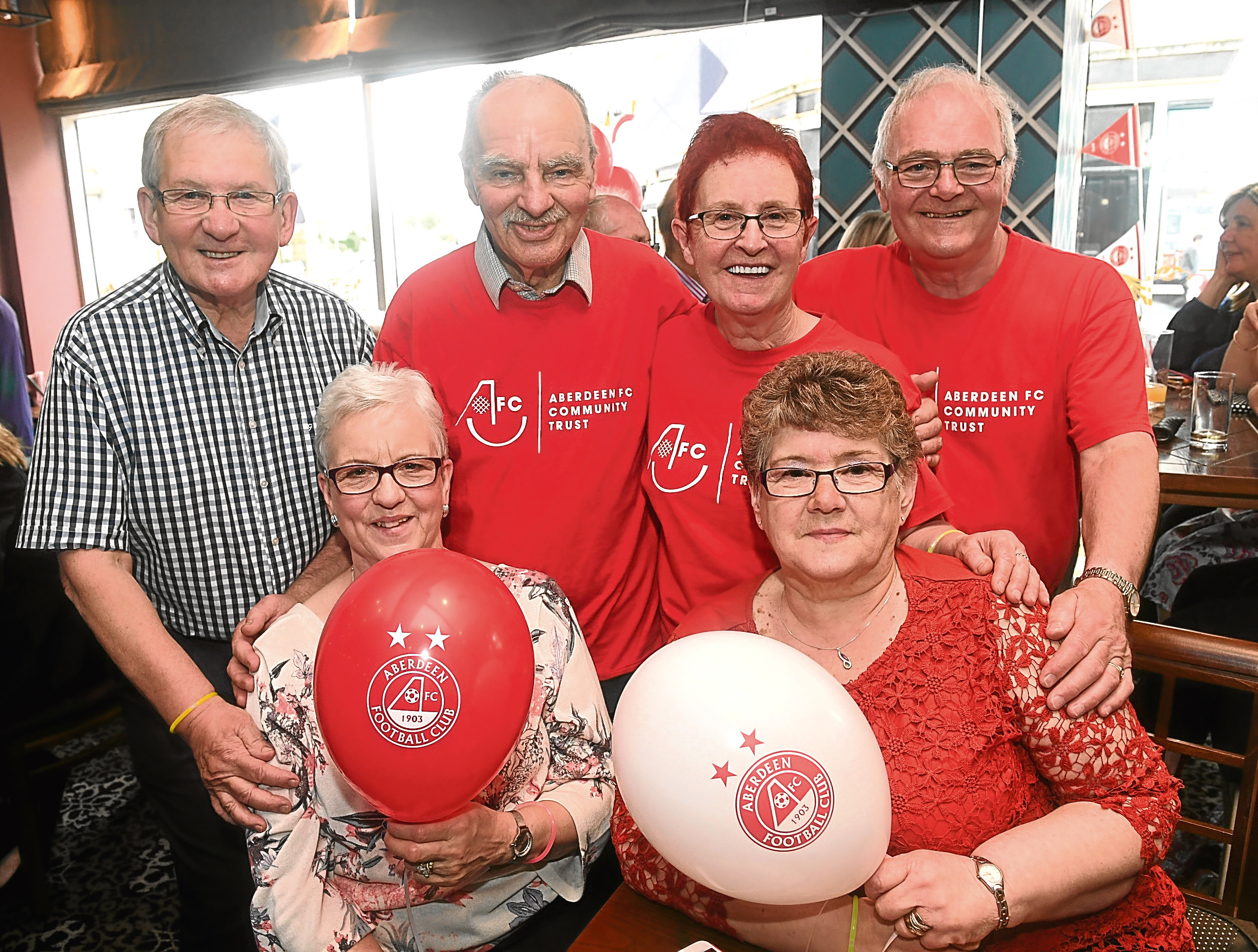 Back, from left, Jim Davidson, Alex Rennie, Marie Douglas and Ronnie Kain from AFC Community Trust and front, from left, Barbara Davidson and Irene Kain.