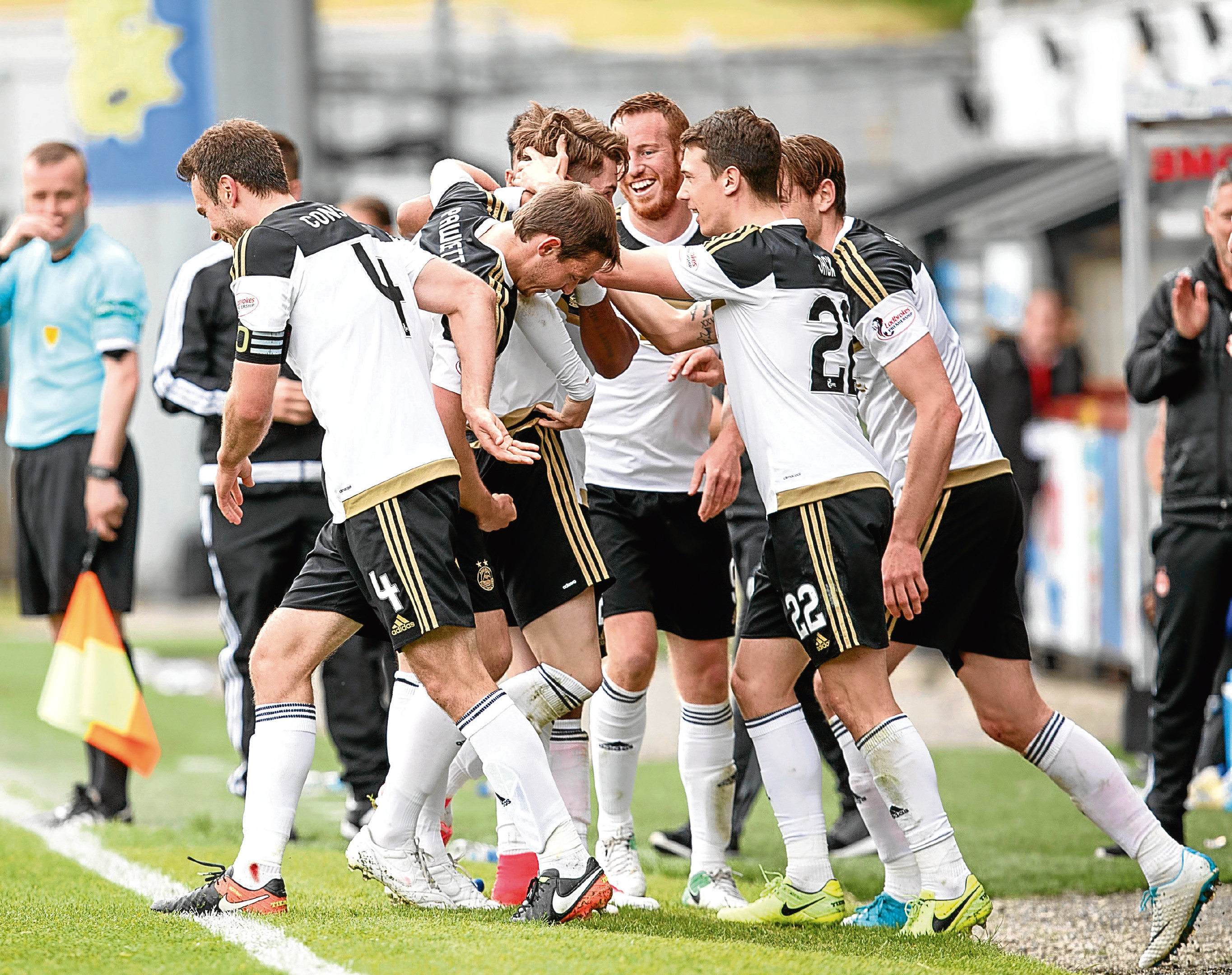 Dons player celebrate at Partick.