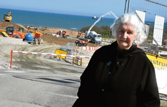 Edna Booth along with other residents from Blackdog have raised concerns over the amount of lorries and vans driving along their road working for the Vattenfall wind substation. Picture by COLIN RENNIE