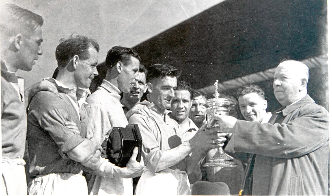 Aberdeen players, including Alex Kiddie, second from right, are presented with the Southern Cup in 1946.