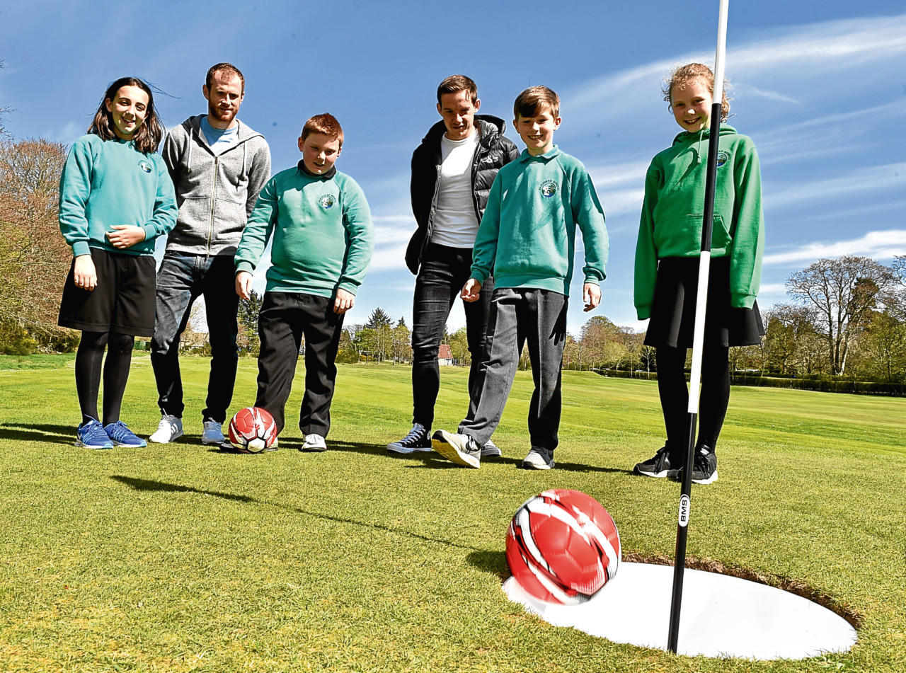 Dons players Mark Reynolds and Peter Pawlett play footgolf at Hazlehead with pupils from Hazlehead Primary School.
