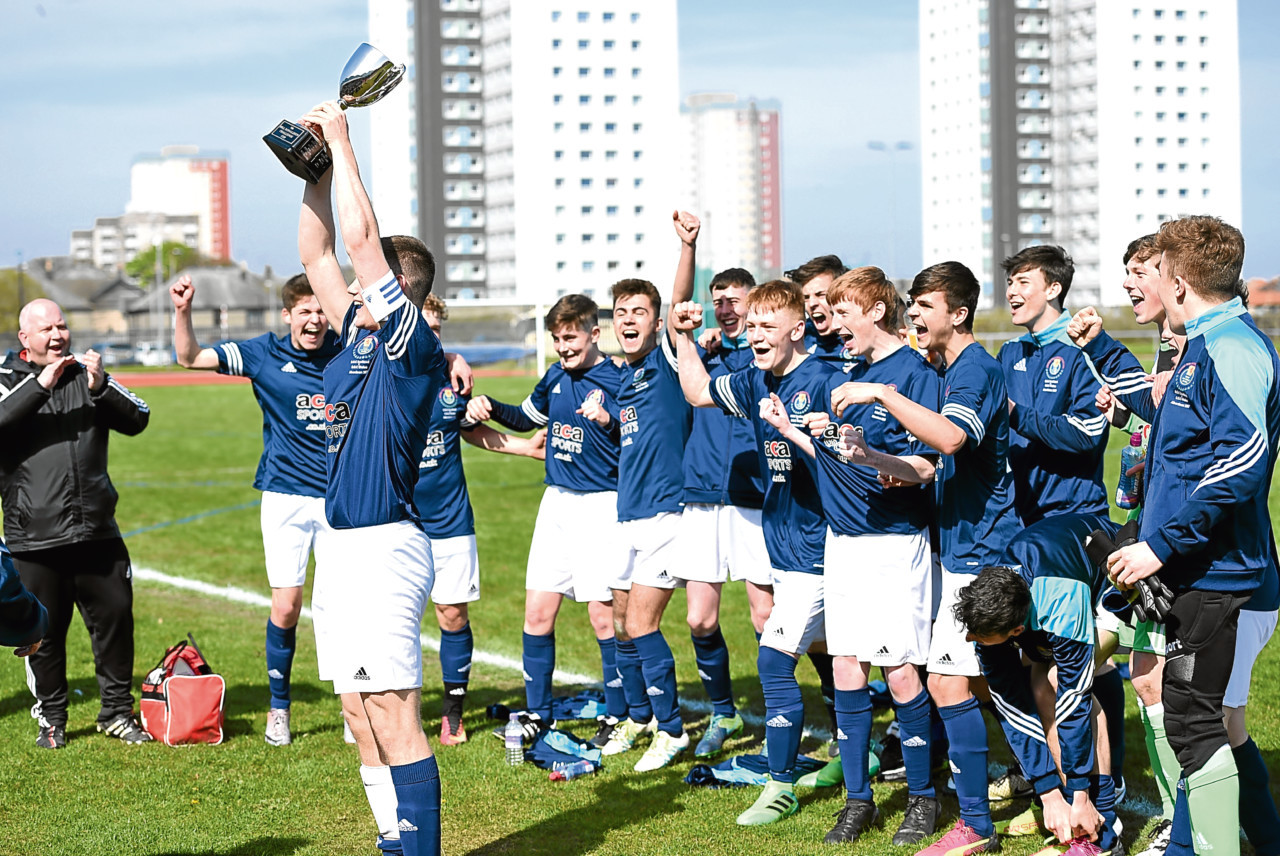 Scotland Under 17s lift the trophy at Aberdeen Sports Village after beating Wales. (Picture by Darrell Benns)
