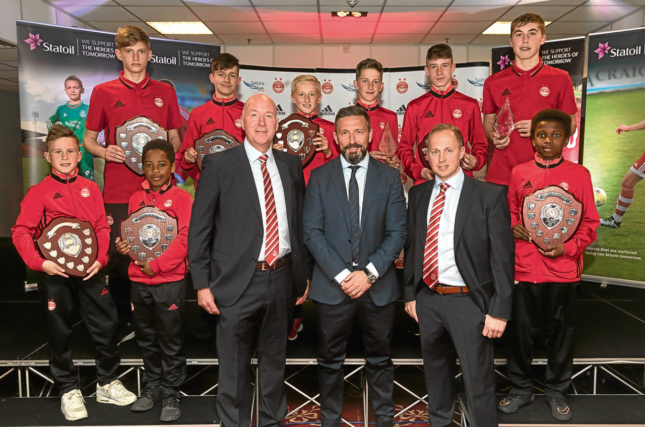 Neil Simpson, Derek McInnes and Gavin Levey with Aberdeen's hot prospects at the club's academy awards night. (Picture by Derek Ironside / Newsline Media.)