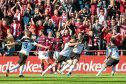 Anthony O'Connor (centre) celebrates after scoring the winner against Hearts.
