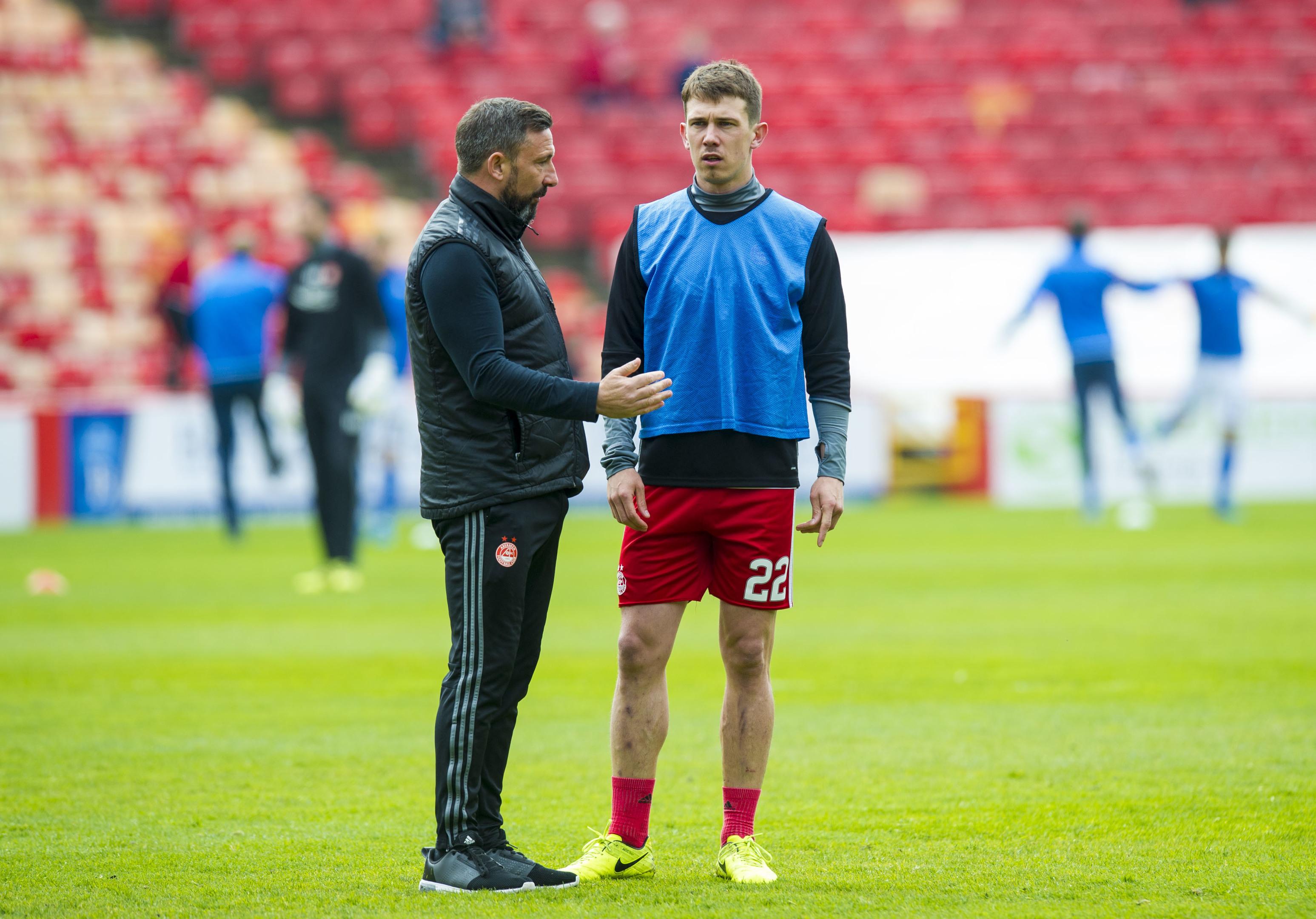 Aberdeen's Ryan Jack warms up with Manager Derek McInnes
