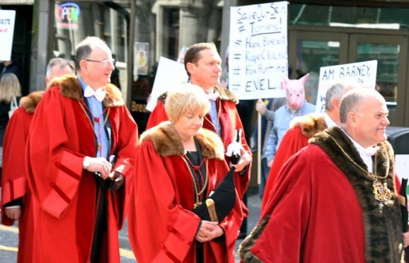 Councillors, including Barney Crockett and Jenny Laing pass protesters