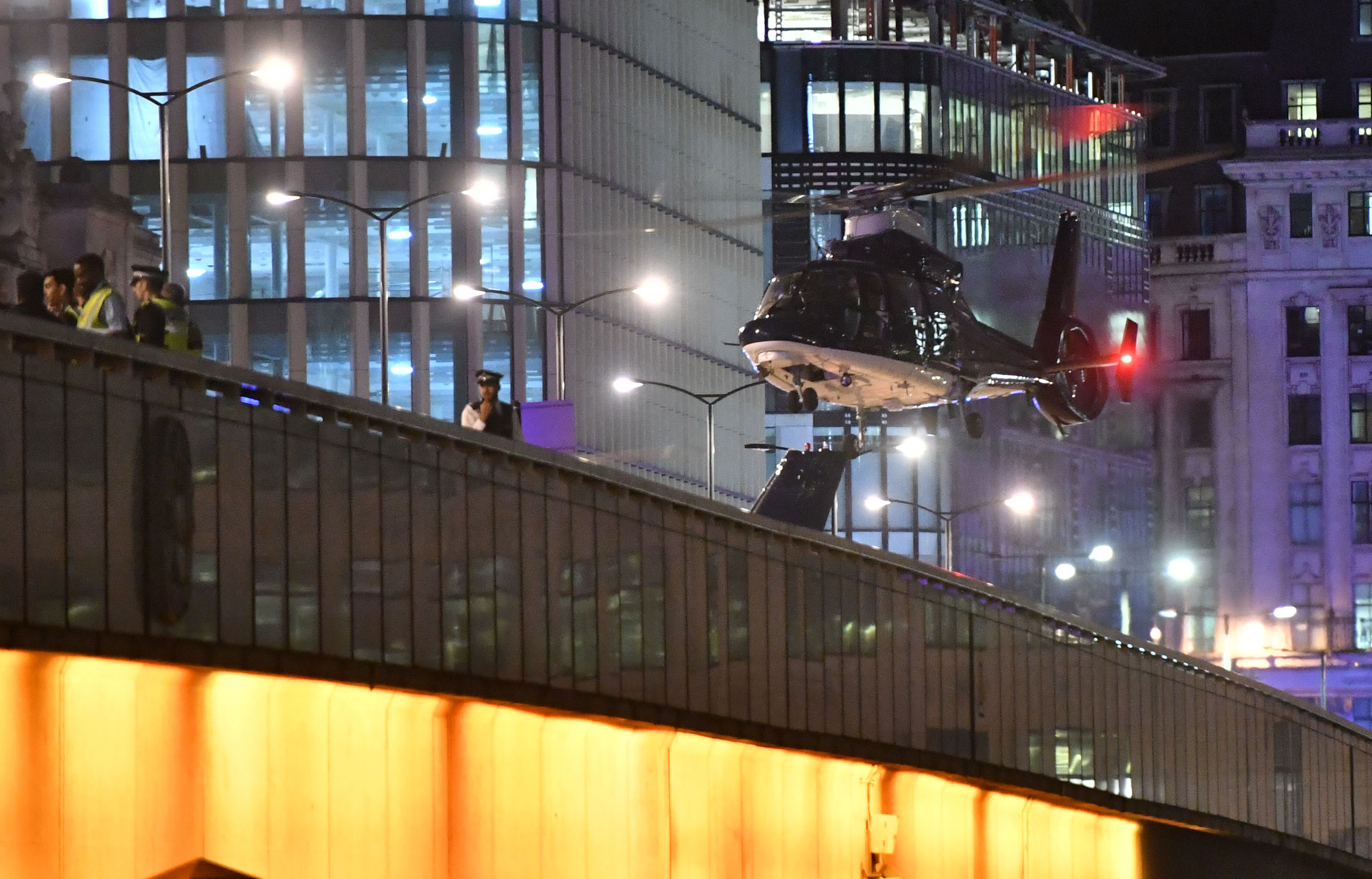 A second helicopter lands on London Bridge.