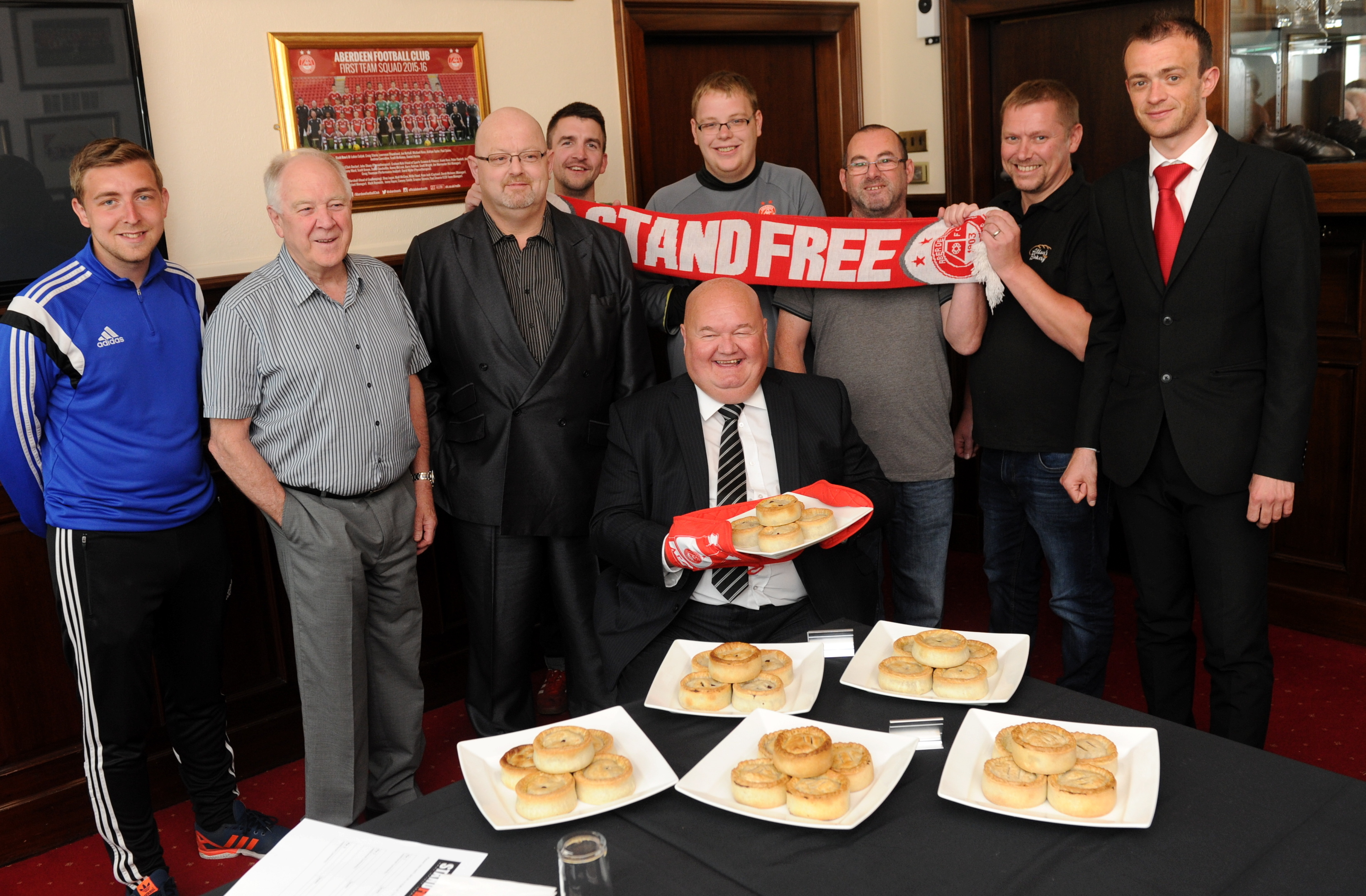 Charlie with the judging panel for the new Pittodrie Pie