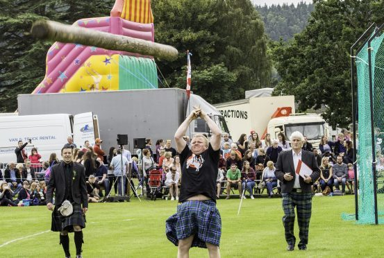 Tommy Fyvie from Aboyne tosses the caber