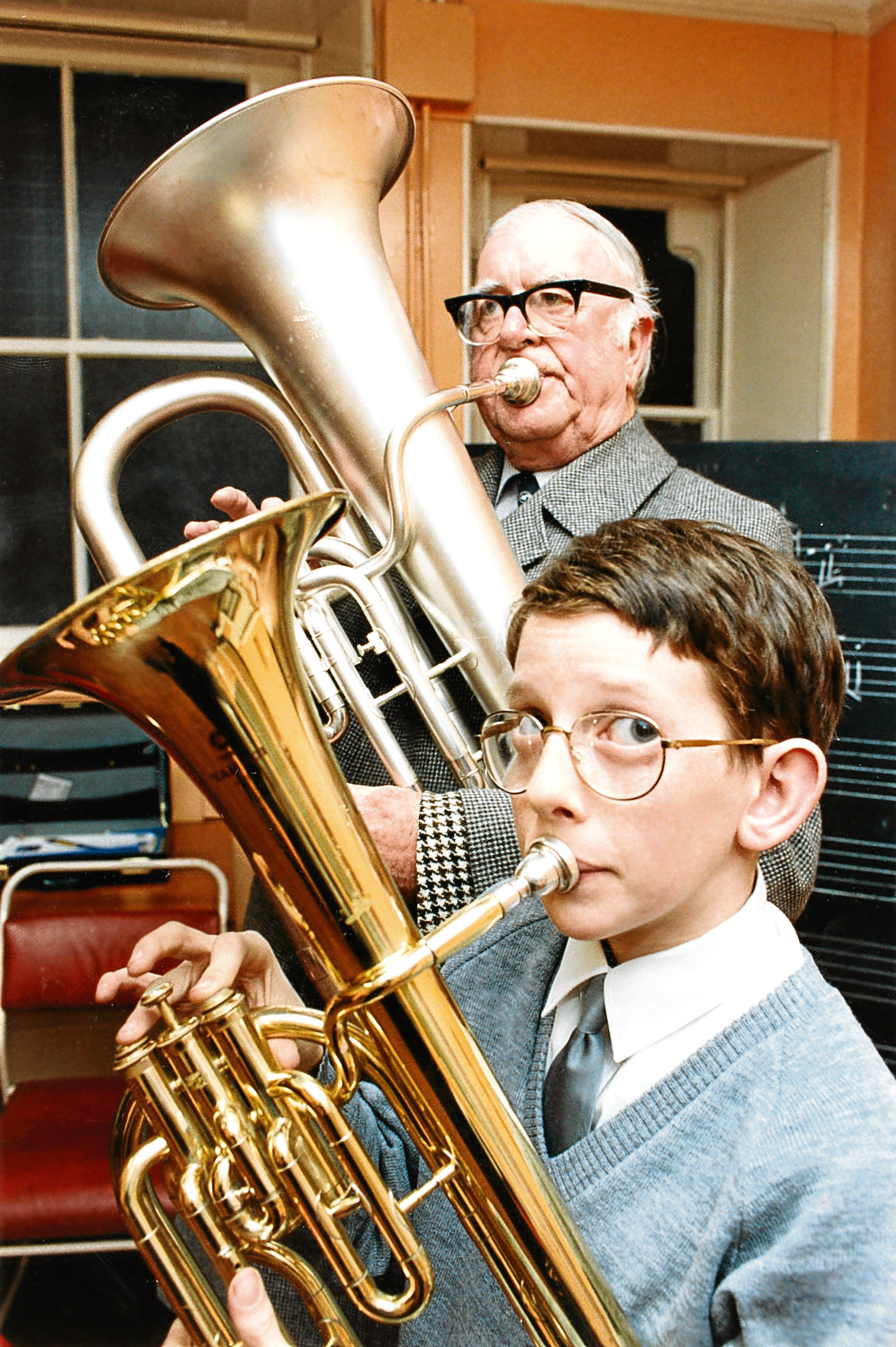 Archie Watt gives tips to Stuart Milton of the Boys' Brigade, Aberdeen Battalion silver band.