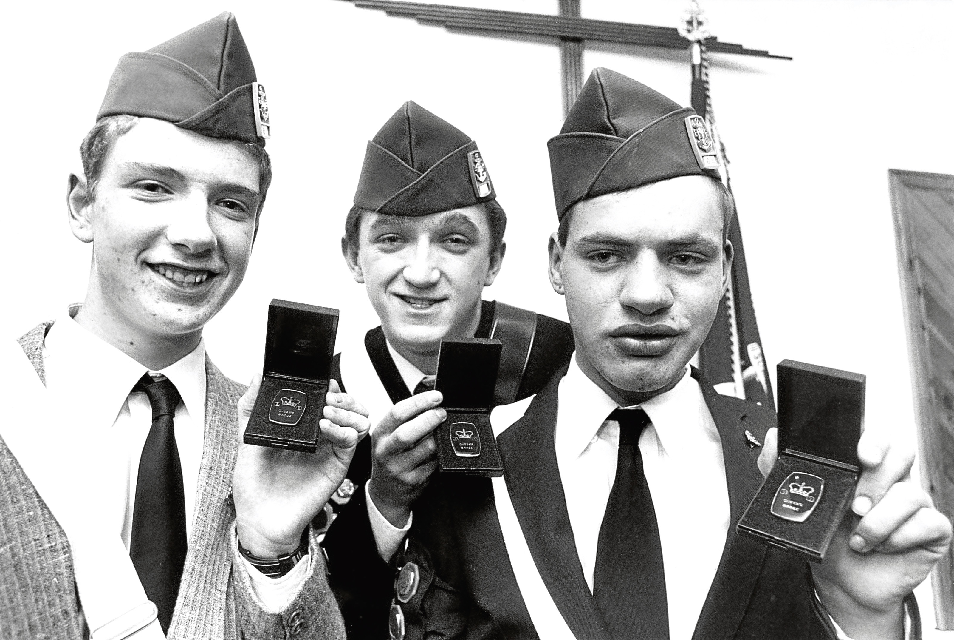 The 68th Bucksburn's , from left, Cpl John Rae, Cpl Richard Mitchell and Sgt Scott Taylor with their Queen's Badges.