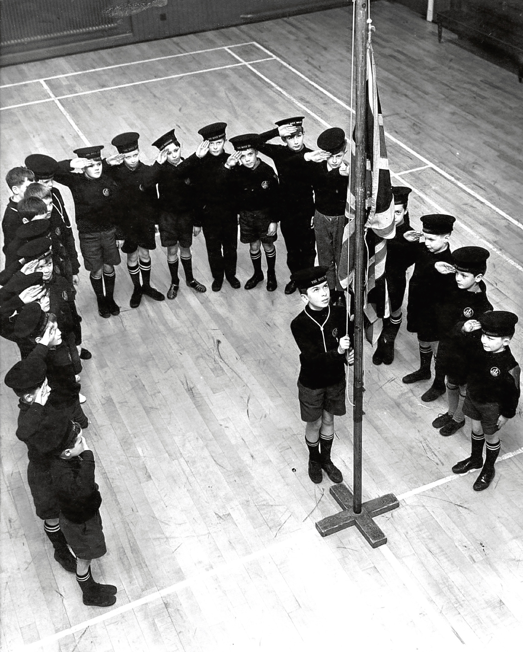 Boys of 9th Company Junior Boys' Brigade (Ruthrieston South Church) practice the flag raising.