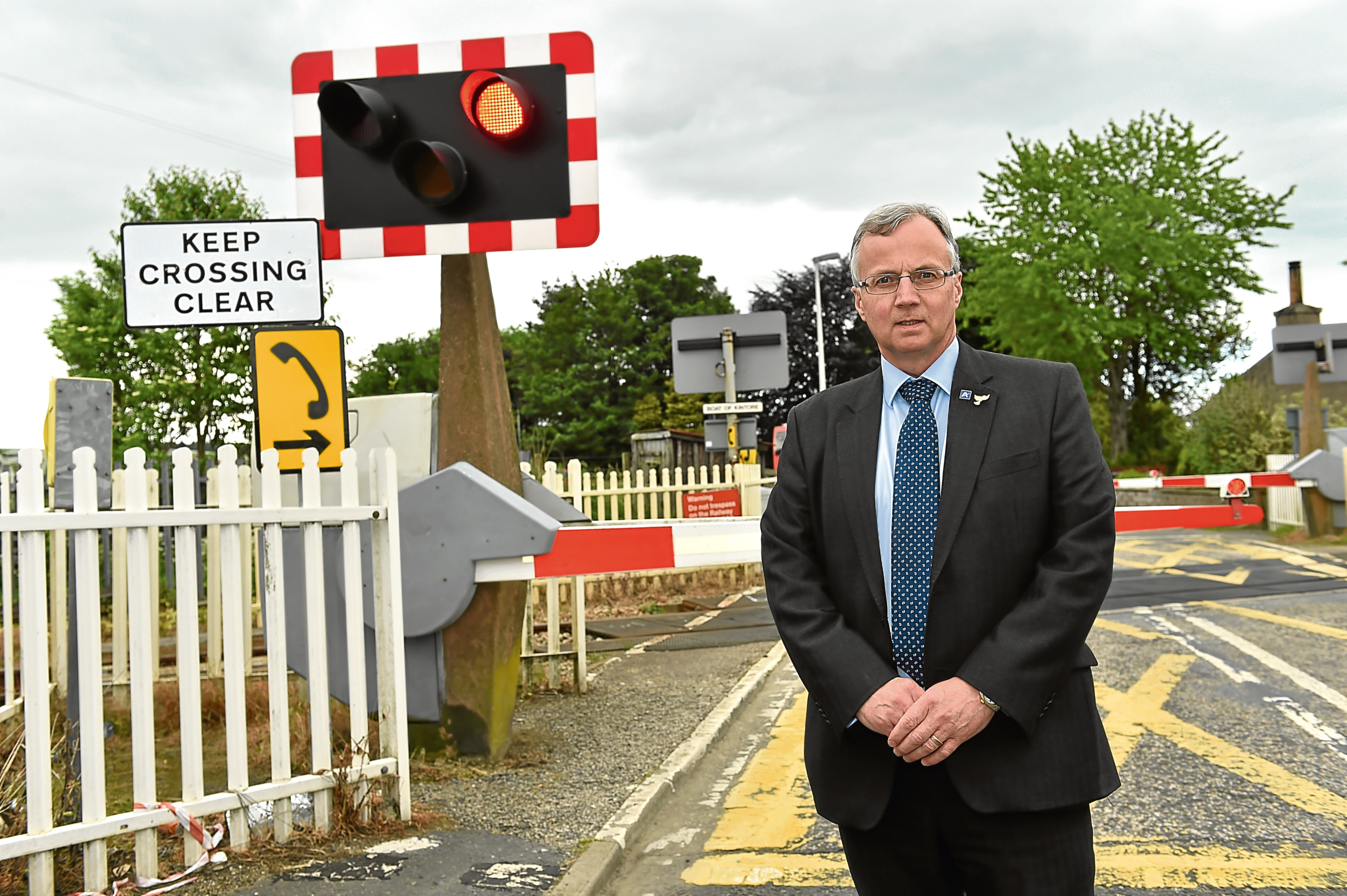 Councillor Fergus Hood at the Kintore level crossing.