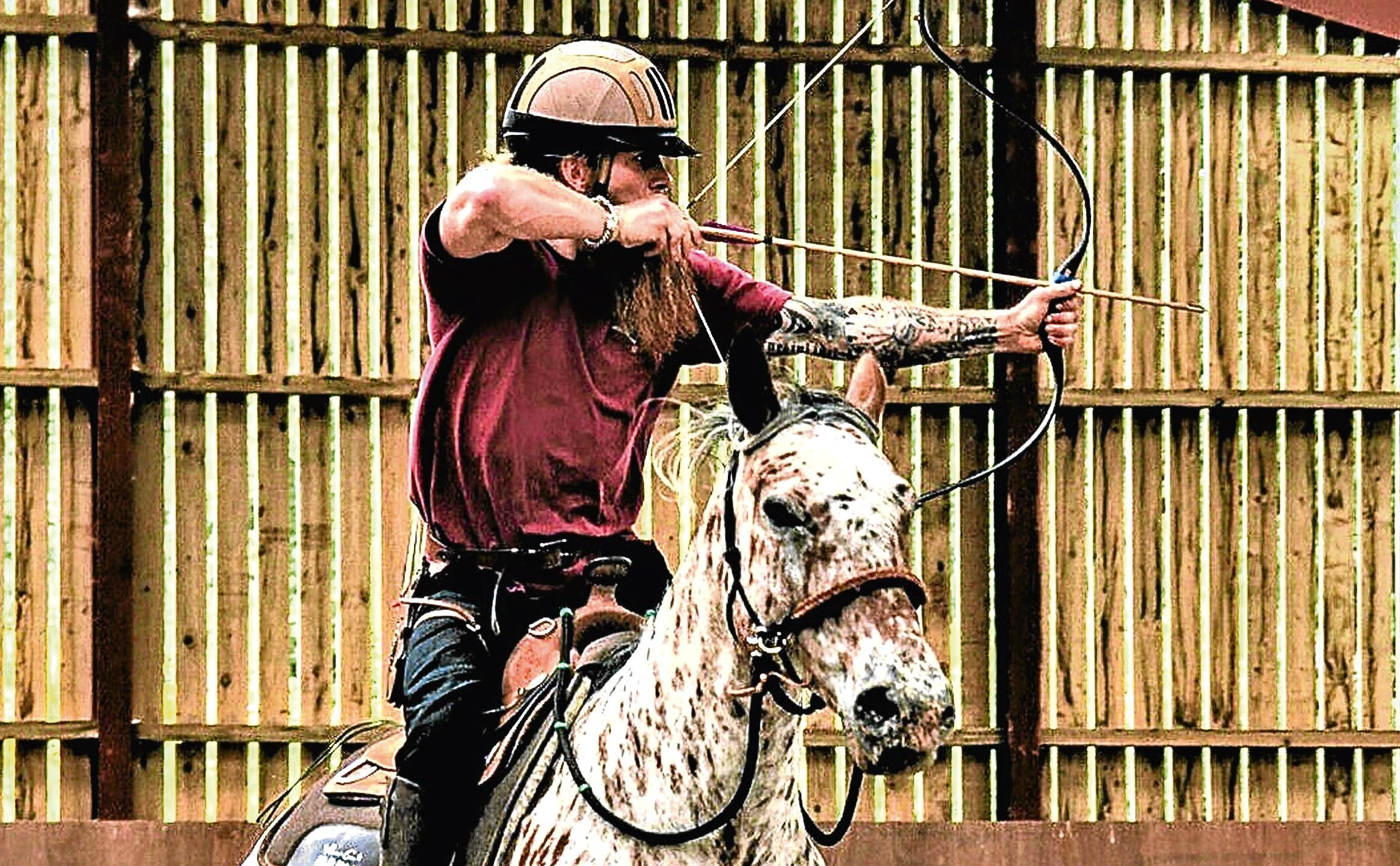 Mike Royall tries some horse archery in Aboyne.