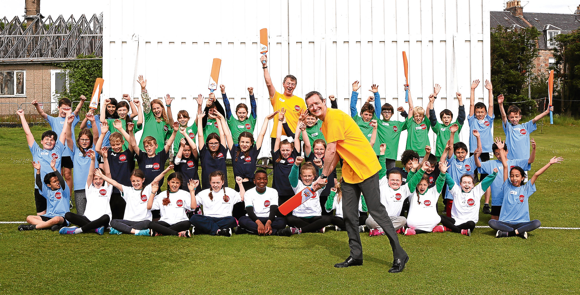 Bob Buchan and Stuart Oag with the children who joined in with the festival at Mannofield.