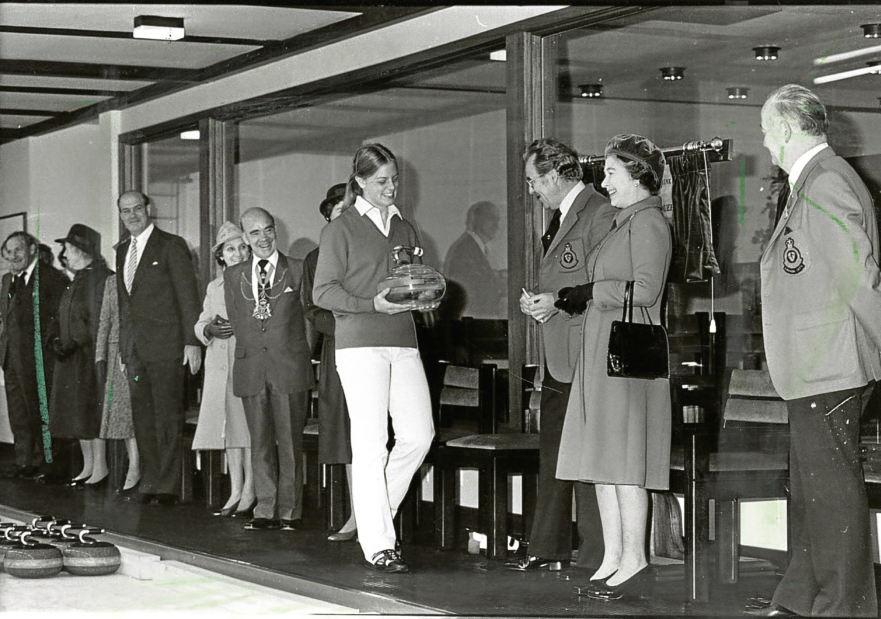 The Queen pictured receiving the Caithness Glass curling stone from Jane Gray, 17, in 1983.