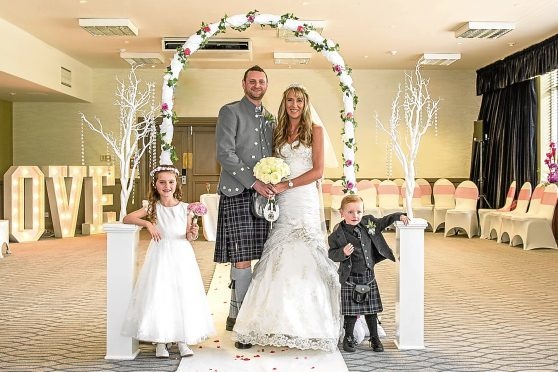 My quine Caroline with her husband Ritchie and children Callie and Jamie. Picture by LoveWeddings